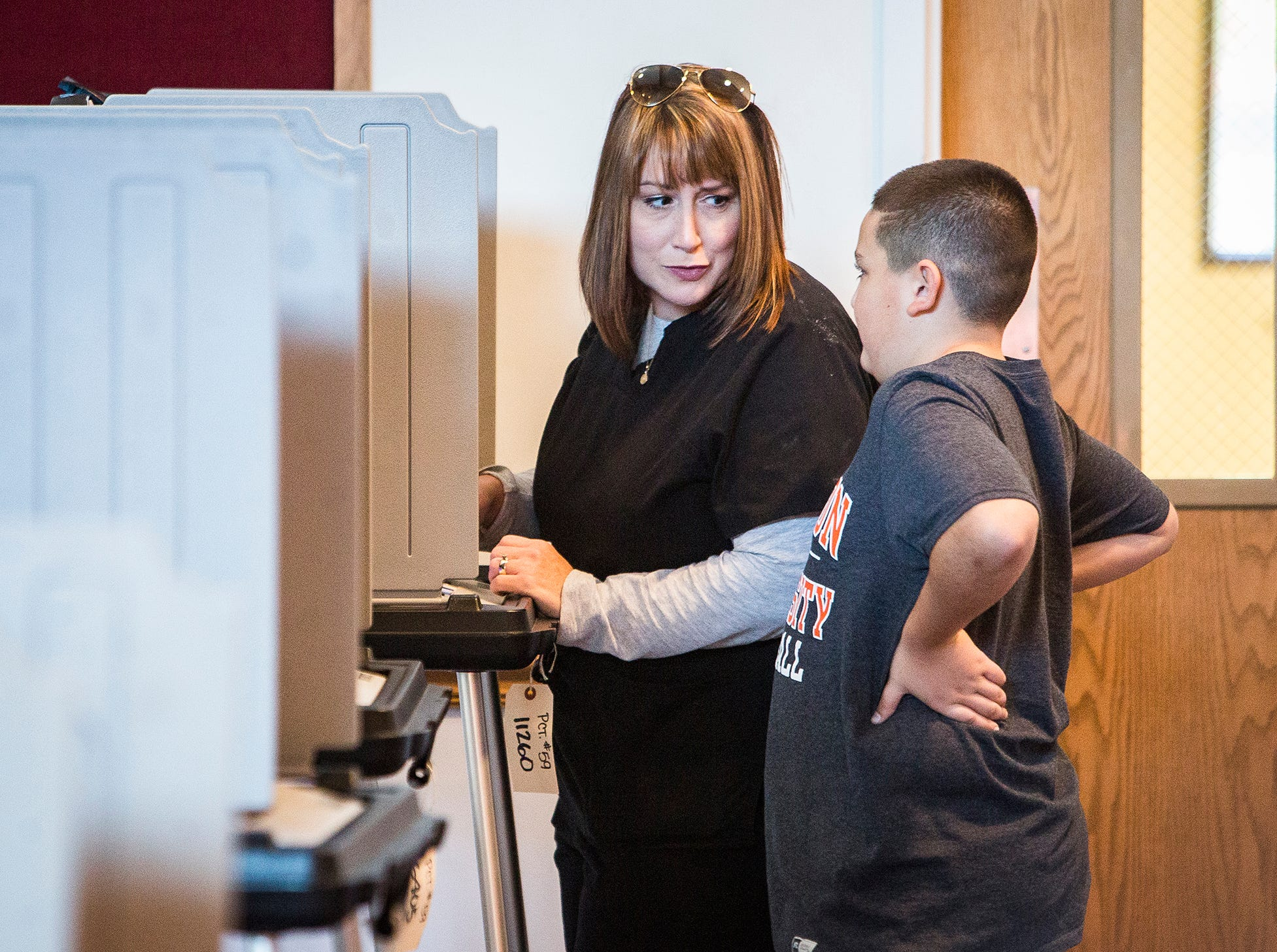 Jennifer Horton casts her vote accompanied by her son, Aiden Branch, at Cornerstone Brethren Church Tuesday.