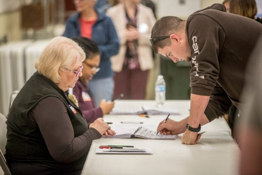 Voters at the Delaware County Fairgrounds had long wait lines for ballot machines before they could cast their vote on Tuesday. While many places reported a busy election day the Fairgrounds for Precinct 27 was abnormally long.