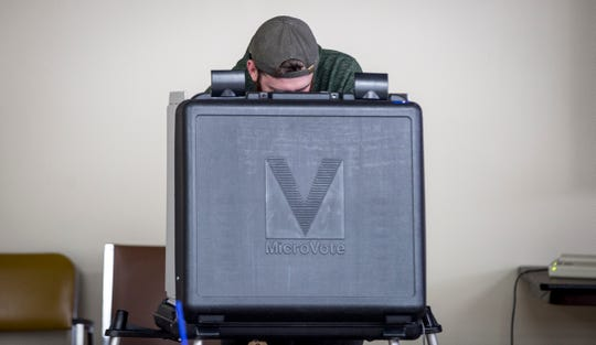 A voter casts a ballot in the November 2018 election.