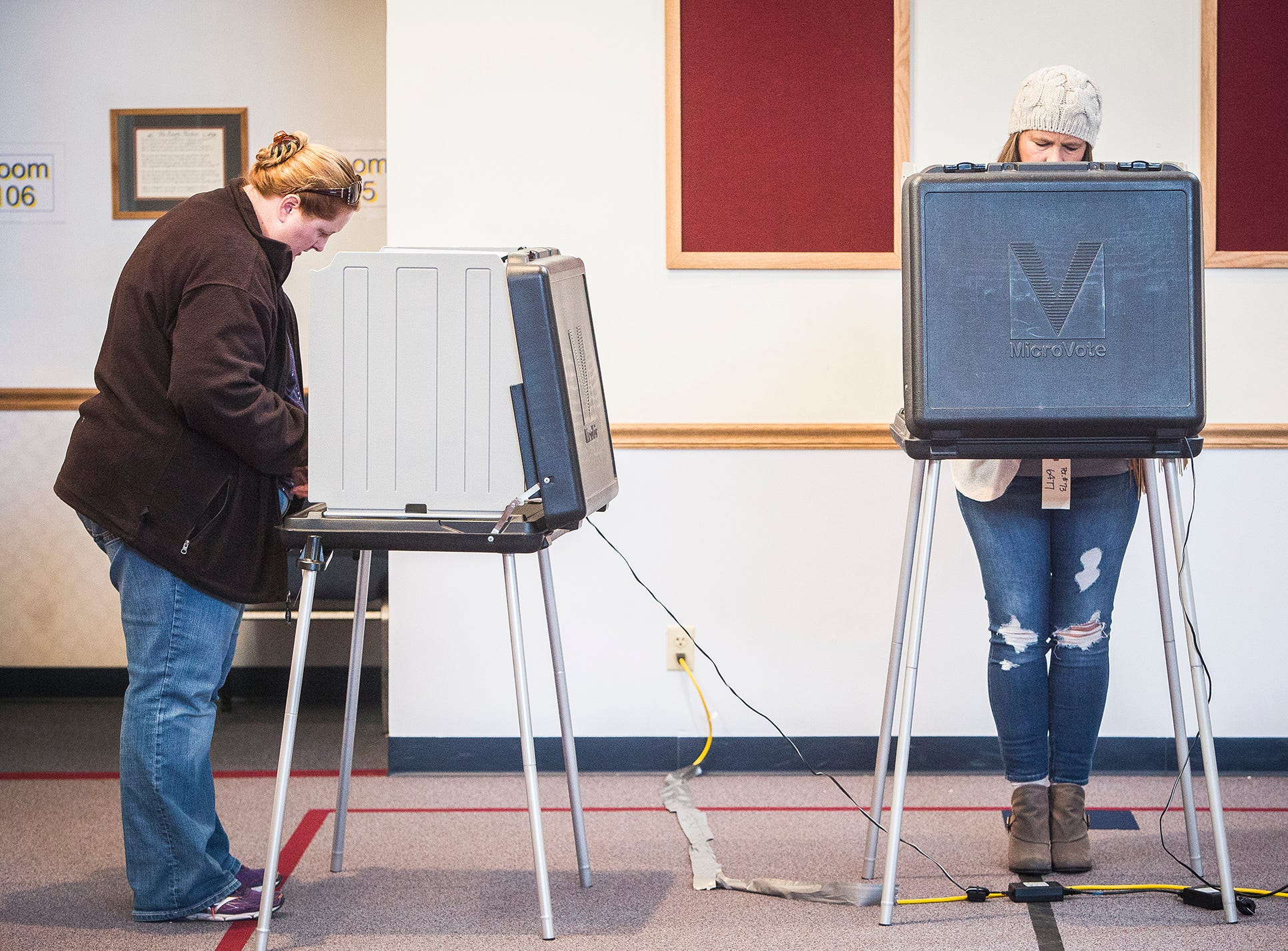 Voters from Precinct 59 and 73 cast their ballots at Cornerstone Brethren Church on Cowan Road Tuesday.