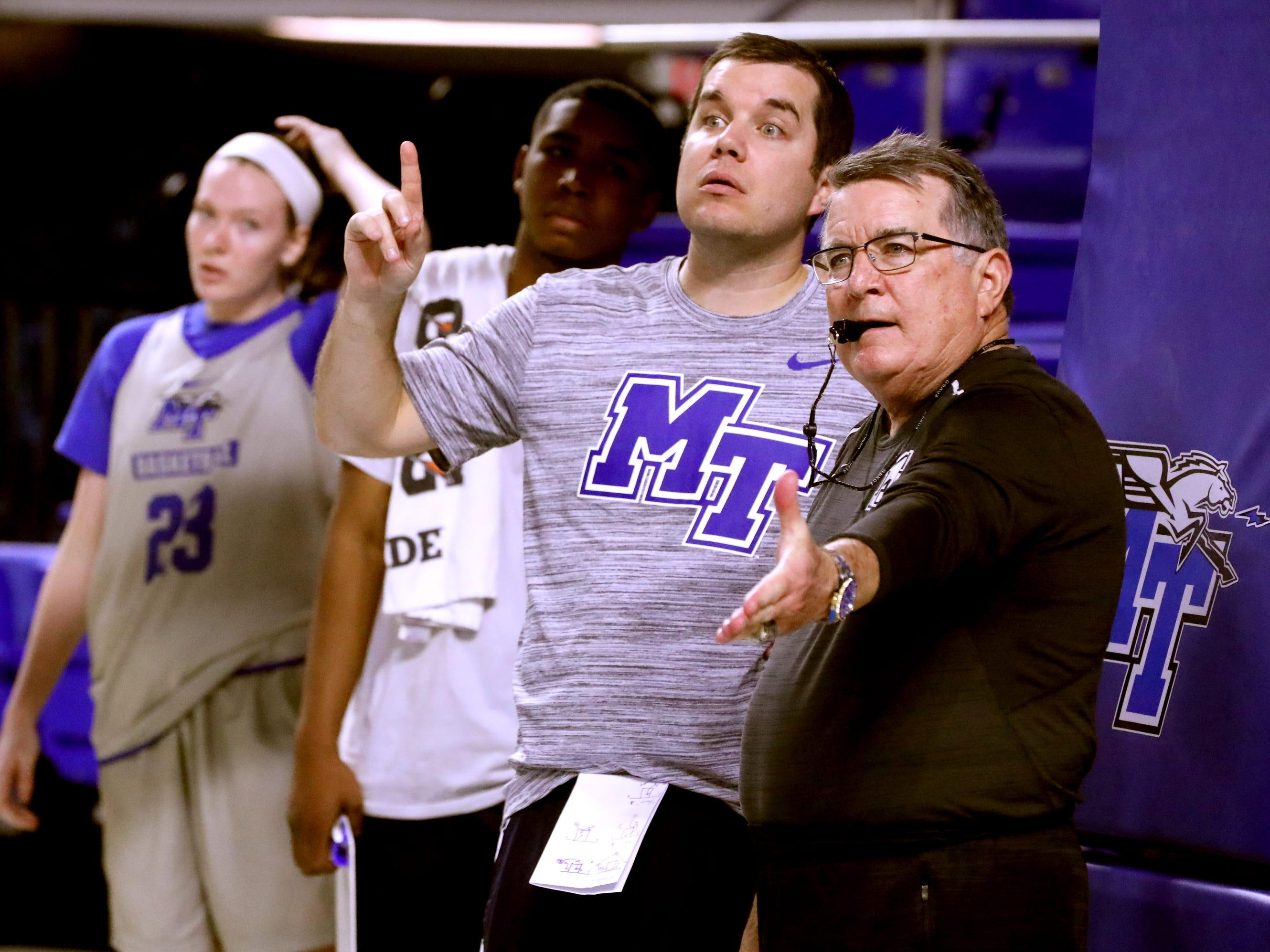 MTSU women's assistant basketball coach Matt Insell, left  and head coach Rick Insell work with players during practice at Murphy Center on Monday, Nov.. 5, 2018.