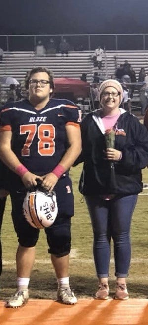 Blackman offensive lineman Micheal Brown (left) is pictured with his mother, Crystal, on a recent senior night. Crystal Brown has been one of the biggest supporters of the Blaze while also battling breast cancer.