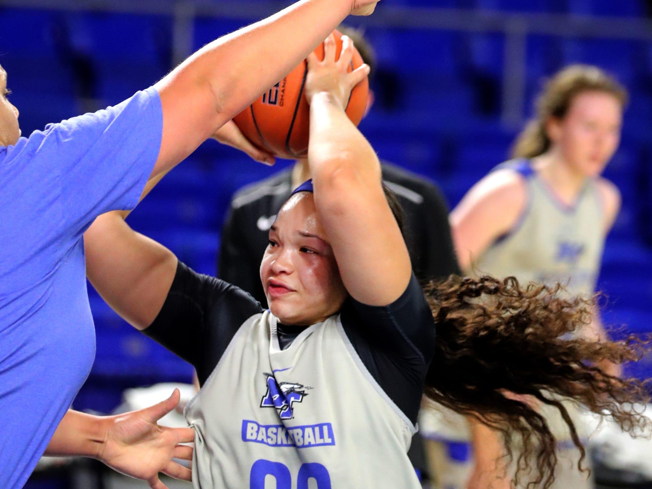 MTSU's Alex Johnson (00) moves in toward the goal during MTSU women's basketball team practice at Murphy Center on Monday, Nov.. 5, 2018.