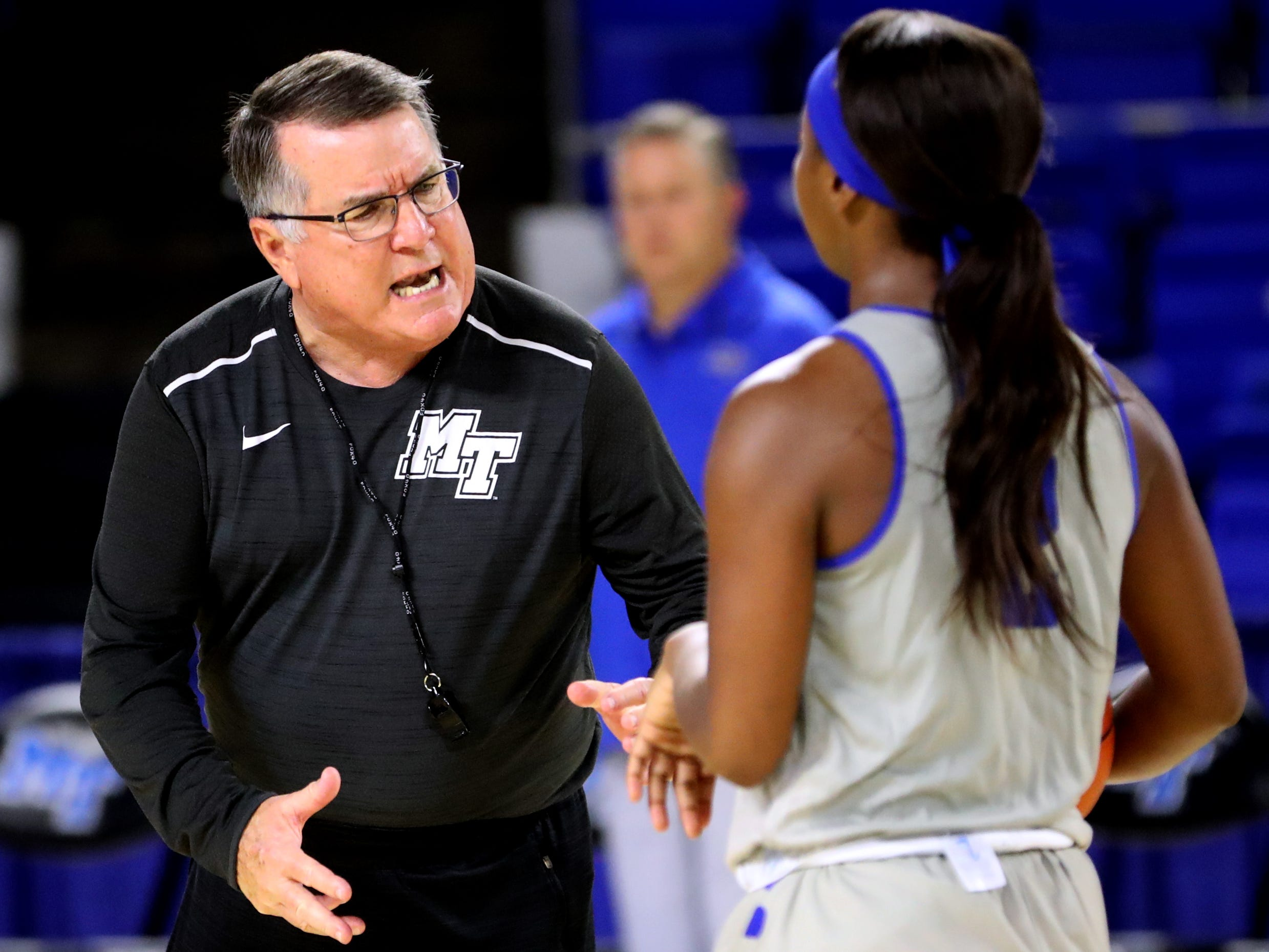 MTSU women's head basketball coach Rick Insell works with Taylor Sutton (2) during practice at Murphy Center on Monday, Nov.. 5, 2018.