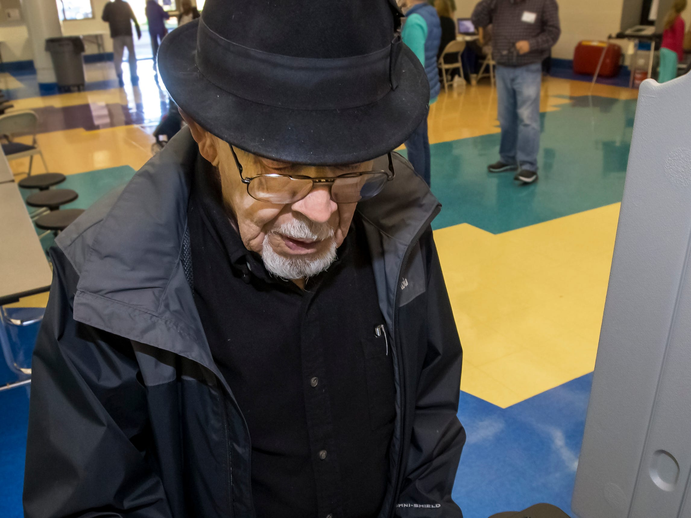 Bethel Hill, 91, votes at Siegel Middle School Tuesday morning. He has not missed a voting day since he turned 21.