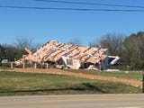 An Ef-2 tornado ripped through Middle Tennessee overnight claiming at least one life