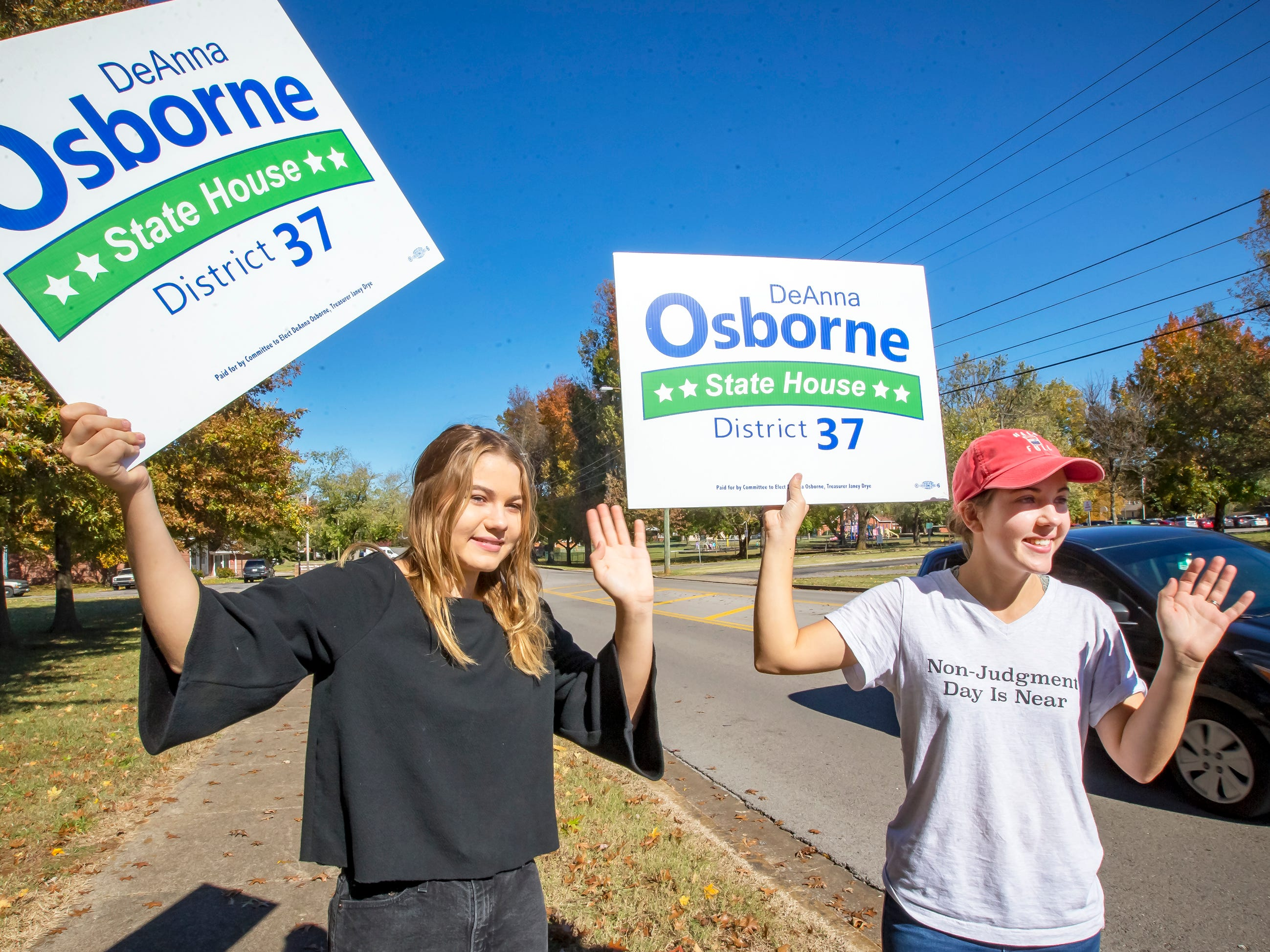 Sisters Caitlyn Parris and Loren Osborne campaign for their mother, DeAnn Osborne, at the Mitchell-Neilson polling site in Murfreesboro.