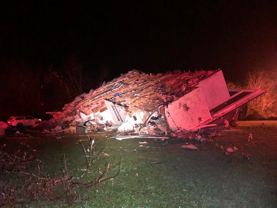 Emergency crews say a possible tornado blew a house off its foundation, killing a woman early Tuesday morning, Nov. 6, 2018.