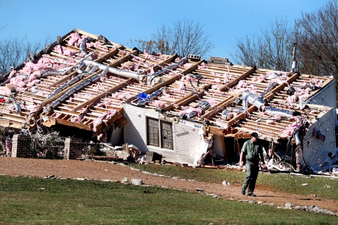 A home rests on its side after a tornado blew the family's house off its foundation, killing a woman overnight on Midland Road Tuesday, Nov. 6, 2018, in Christiana, Tenn.