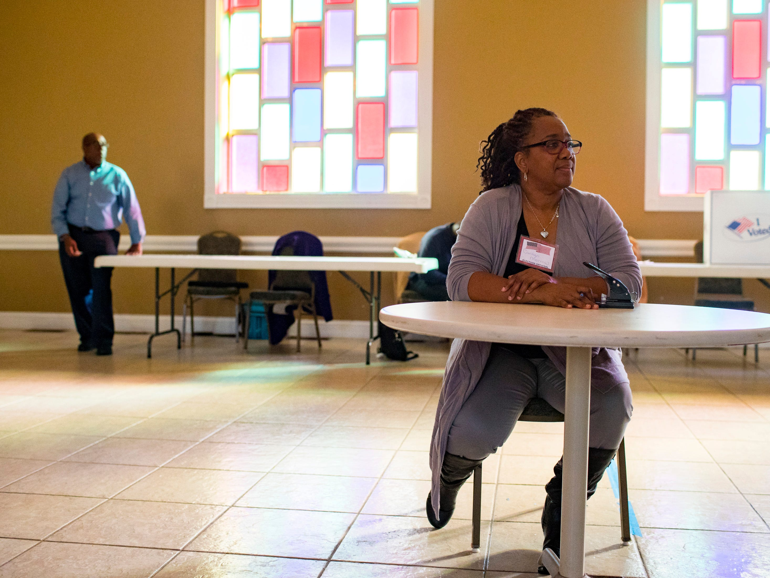Election official Carolyn Morrow sits at the Cathedral of Praise polling place in Nashville on Tuesday, Nov. 6, 2018.