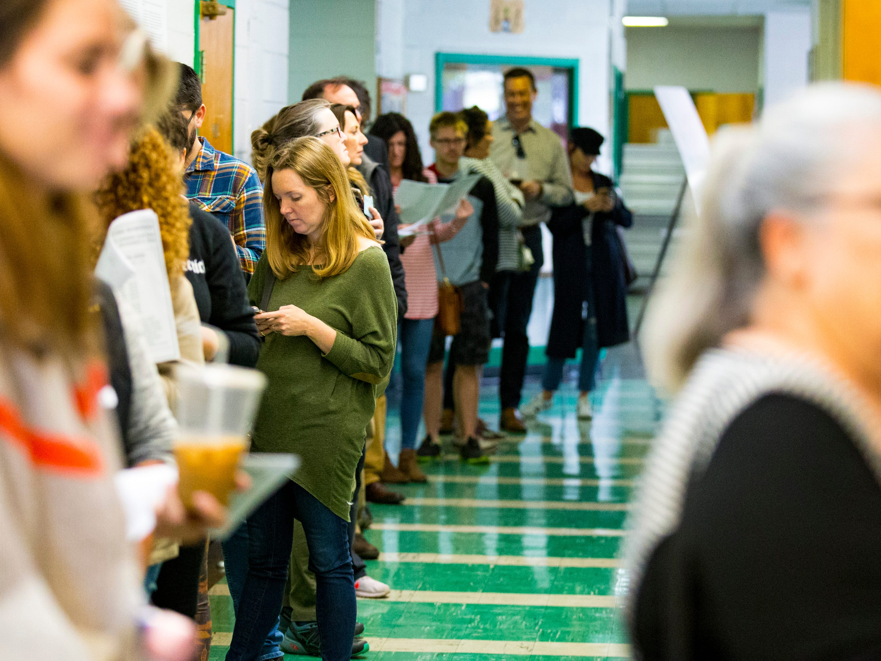 The line to vote stretches down the hallway at the Shelby Park Community Center polling place in Nashville on Tuesday, Nov. 6, 2018.