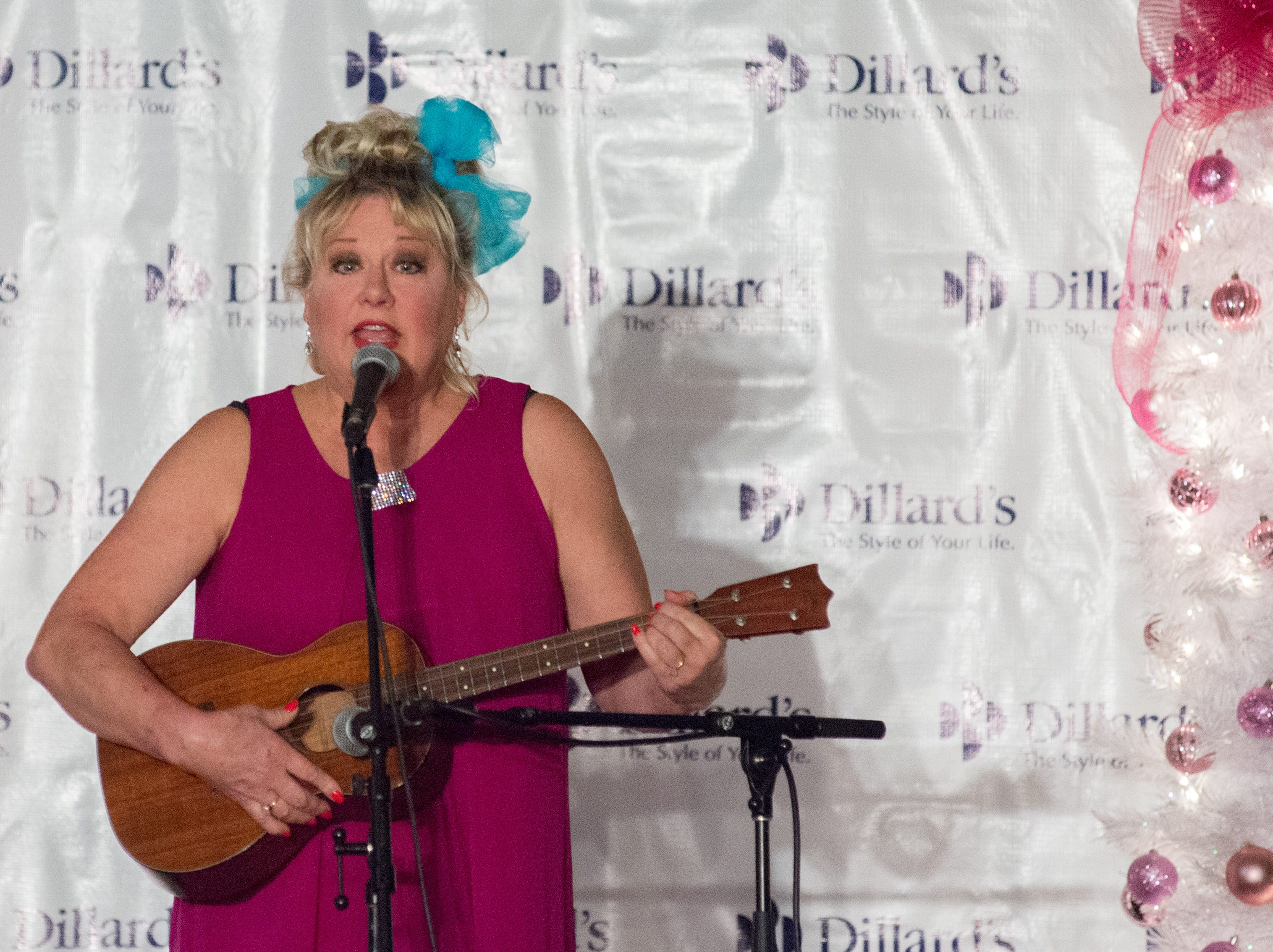 Victoria Jackson performs during the Garlands & Glitter Fashion Show by Dillard's presented by Hendersonville HolidayFest at Bluegrass Yacht and Country Club in Hendersonville on Saturday, Nov. 3. The event was to benefit the YMCA After Breast Cancer Program.
