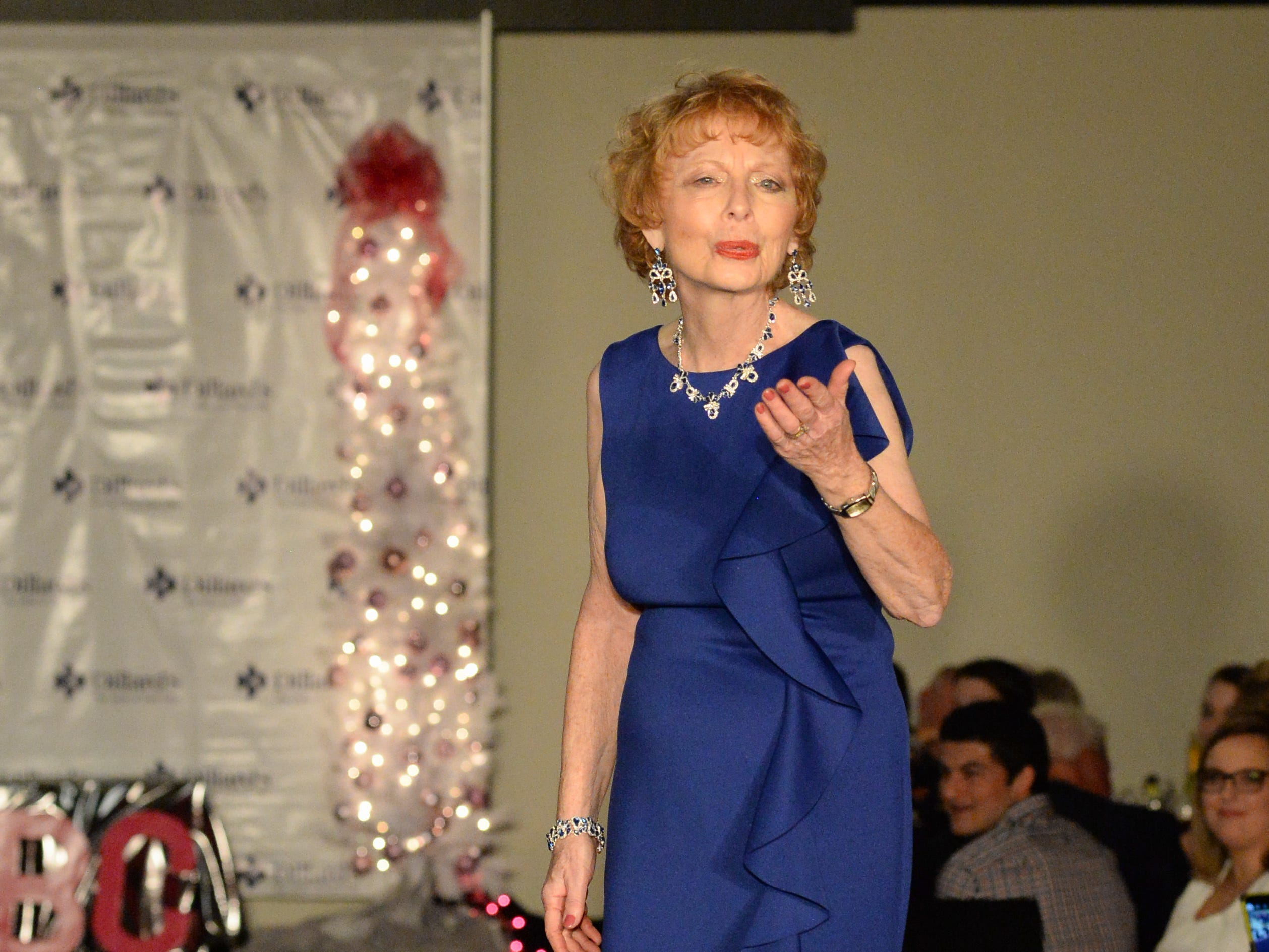 Participants enjoy the Garlands & Glitter Fashion Show by Dillard's presented by Hendersonville HolidayFest at Bluegrass Yacht and Country Club in Hendersonville on Saturday, Nov. 3. The event was to benefit the YMCA After Breast Cancer Program.