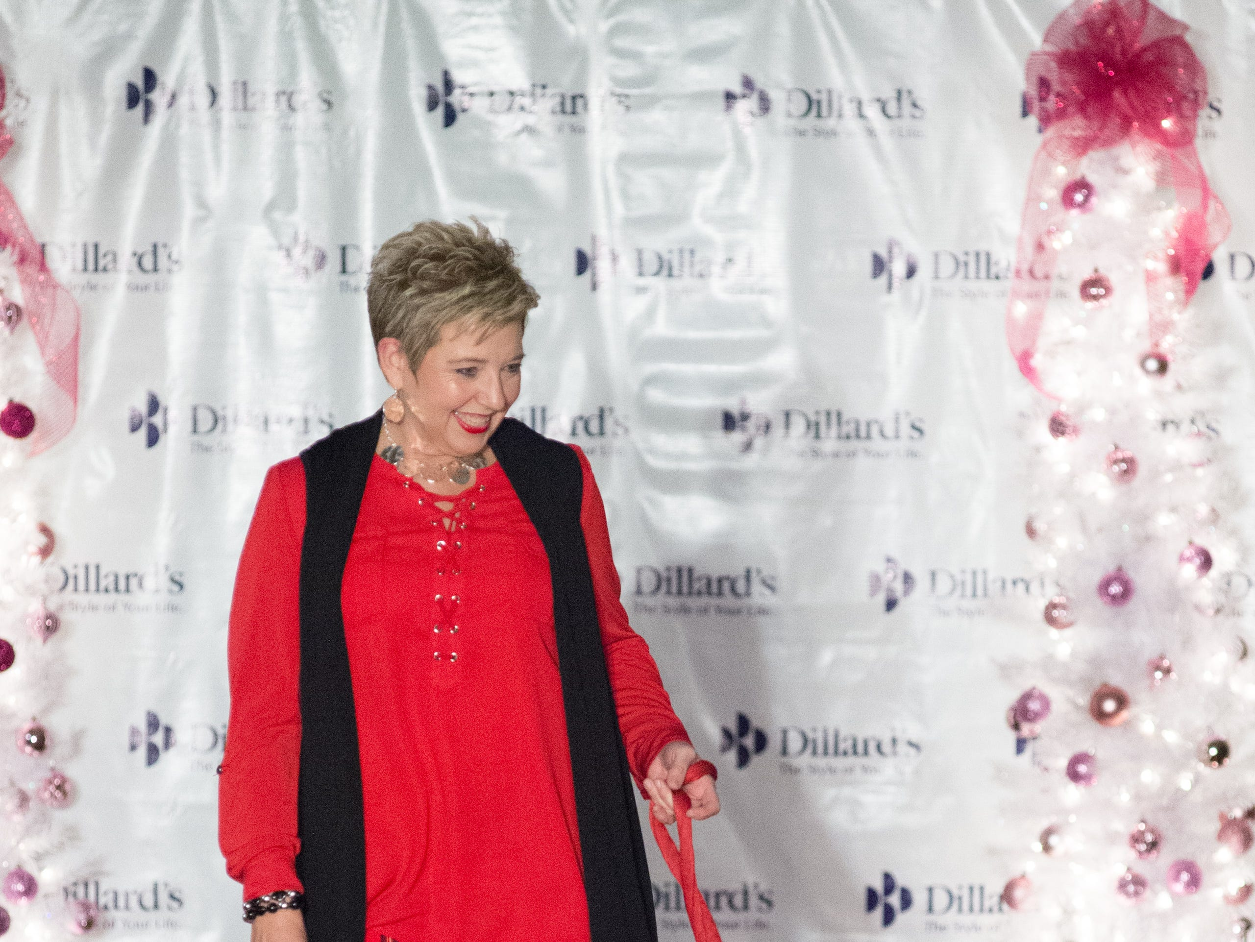 Participants have fun during the Garlands & Glitter Fashion Show by Dillard's presented by Hendersonville HolidayFest at Bluegrass Yacht and Country Club in Hendersonville on Saturday, Nov. 3. The event was to benefit the YMCA After Breast Cancer Program.