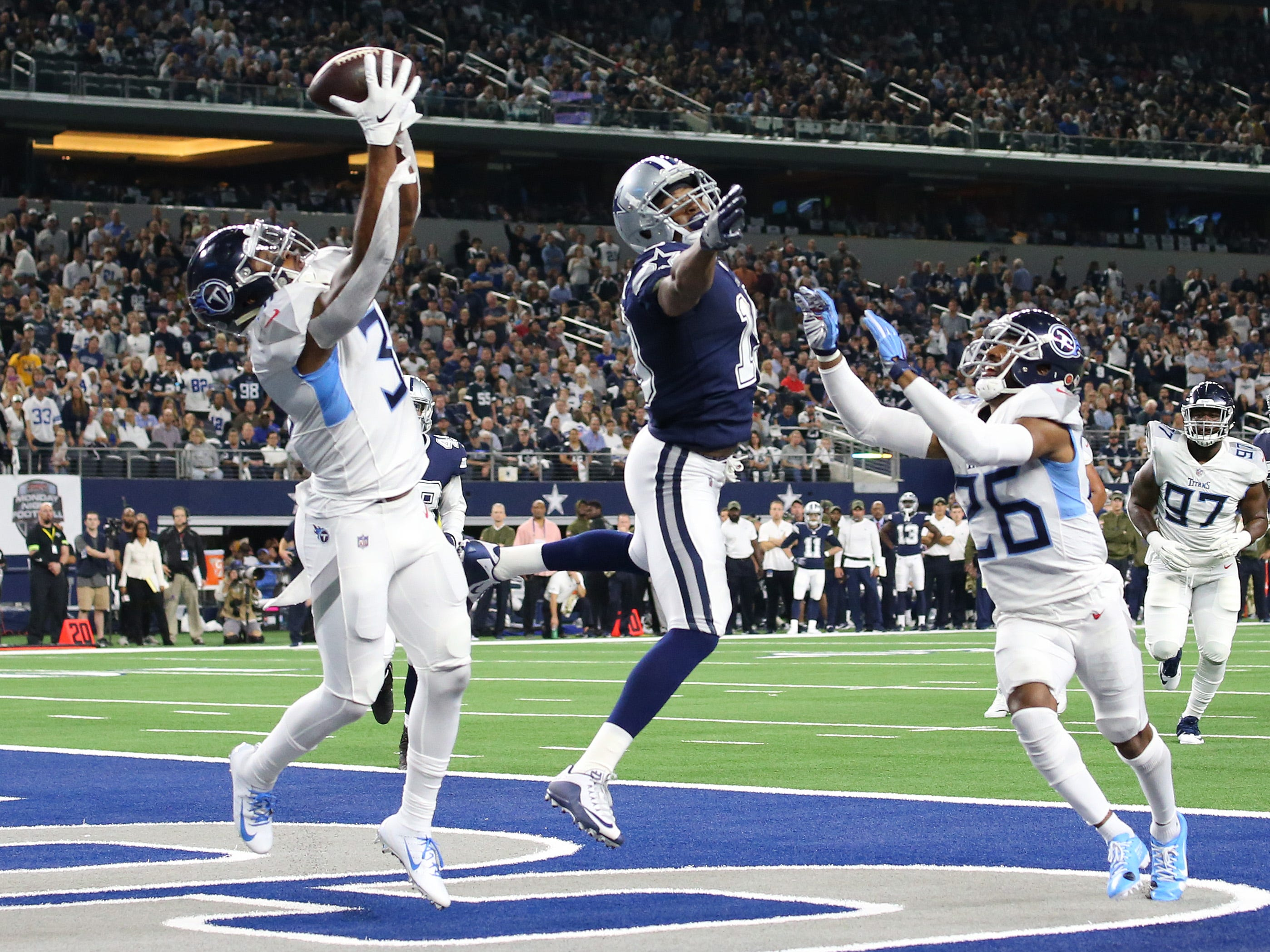 Nov 5, 2018; Arlington, TX, USA; Tennessee Titans safety Kevin Byard (31) intercepts the ball in the end zone intended for Dallas Cowboys receiver Amari Cooper (19) in the first quarter at AT&T Stadium.
