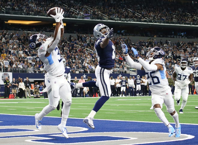Titans safety Kevin Byard (31) intercepts the ball in the end zone in the first quarter Monday night. It was intended for Cowboys receiver Amari Cooper (19).
