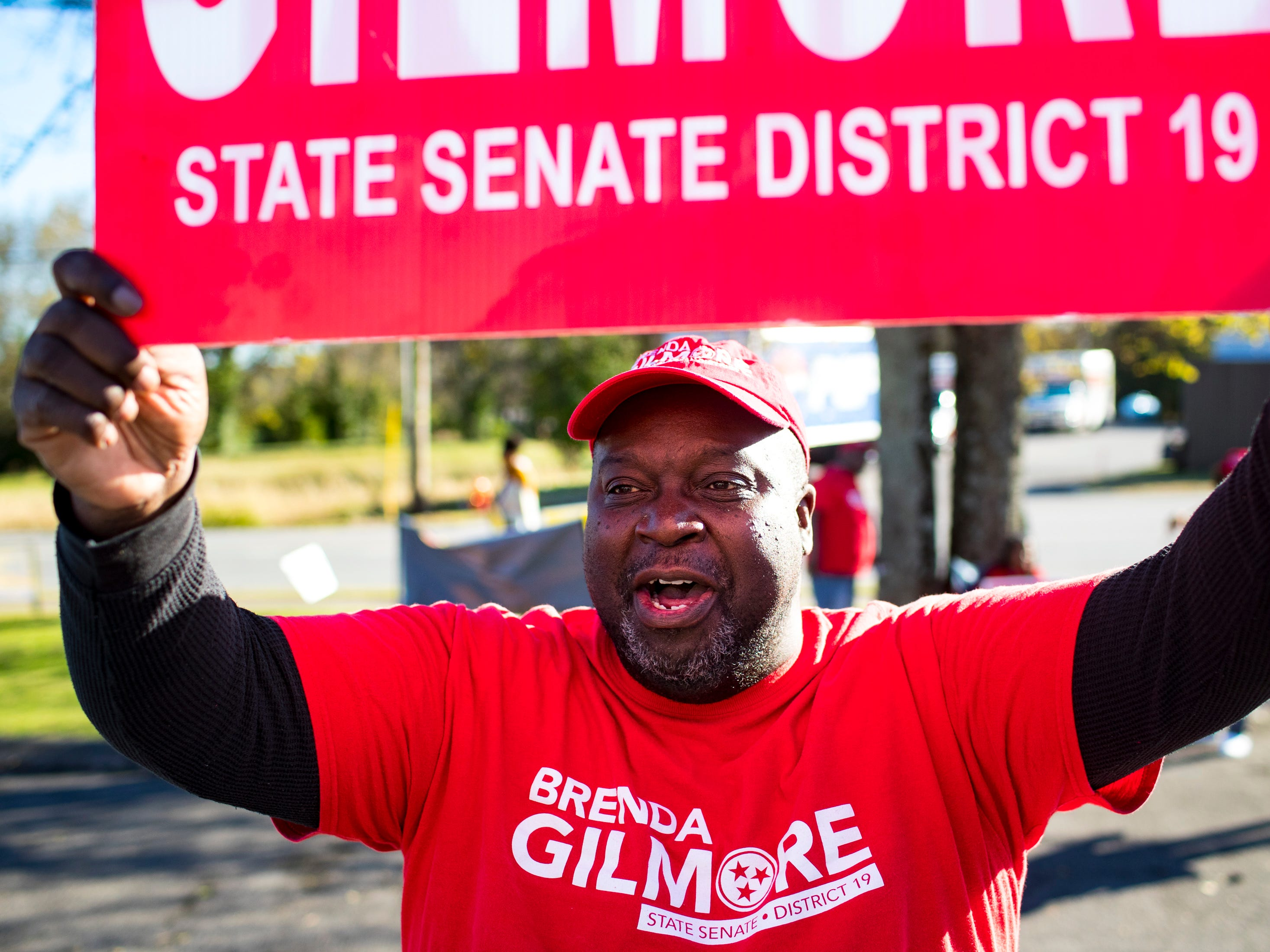 "Greg Washington sings ""we can do more with Brenda Gilmore"" as voters enter the Cathedral of Praise to vote in Nashville on Tuesday, Nov. 6, 2018."