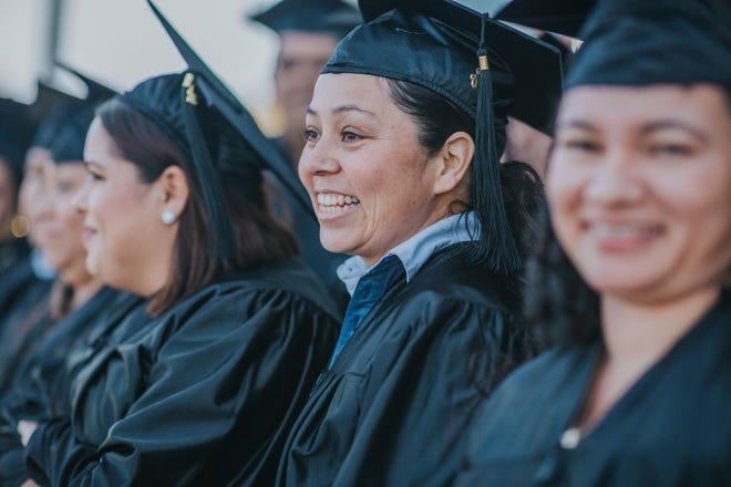Julietta Murillo smiles at the English Under the Arches graduation ceremony at McDonald's in Gallatin.