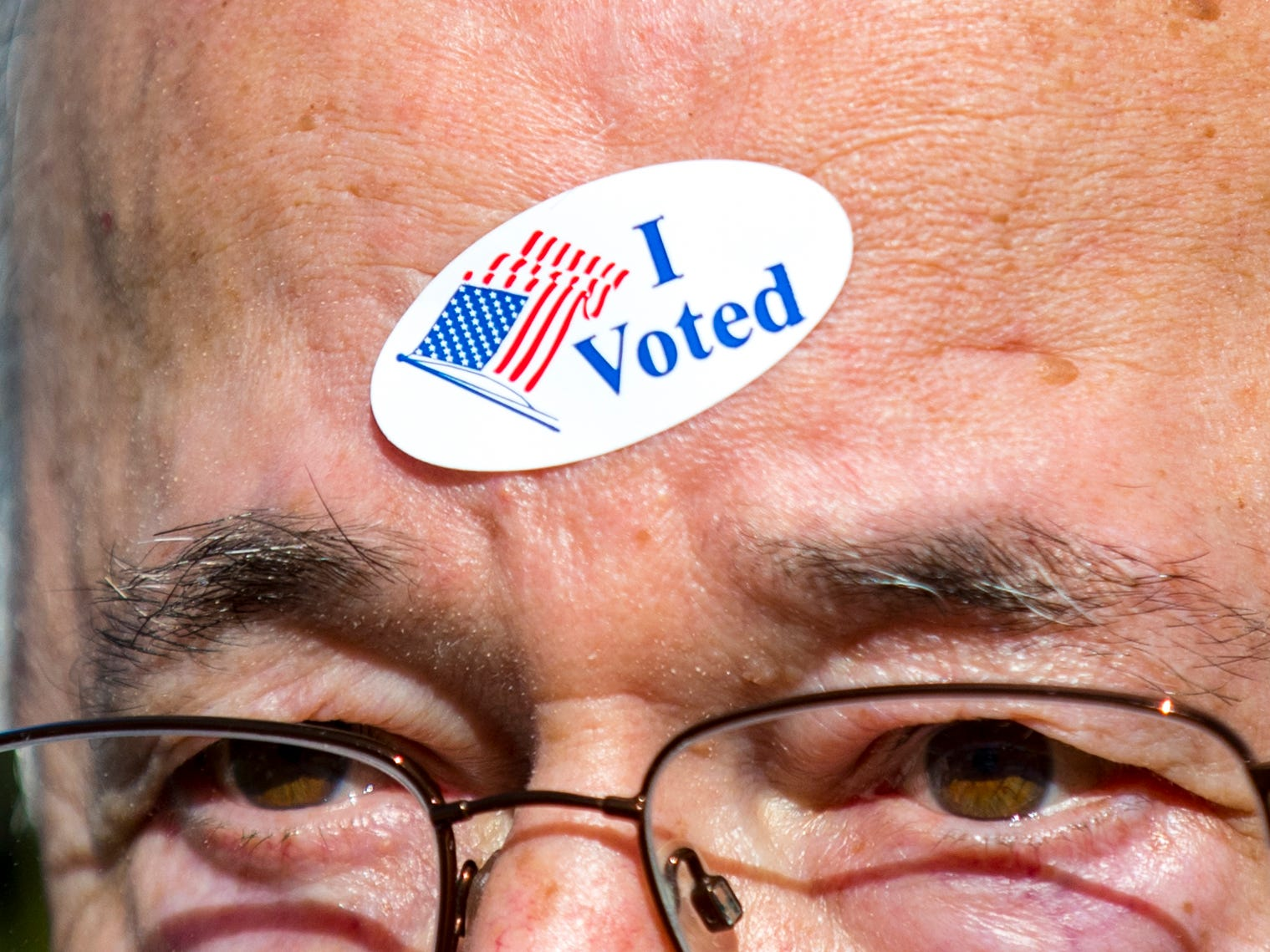 "Stewart Kresge wears his ""I Voted"" sticker on his forehead outside of the Hillsboro Presbyterian Church polling place in Nashville on Tuesday, Nov. 6, 2018."