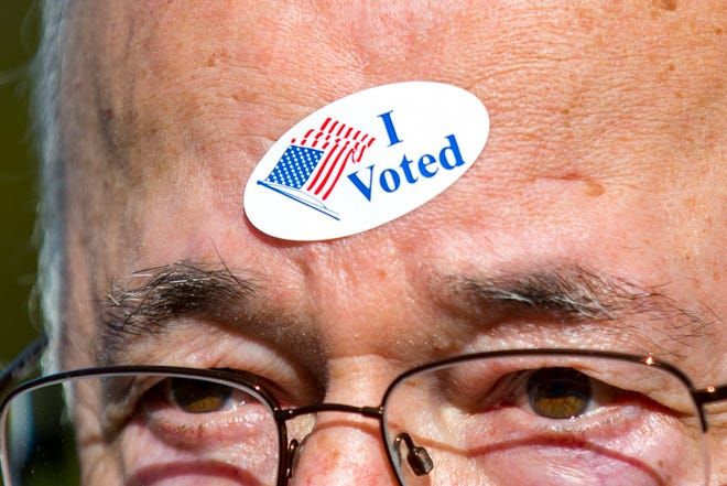 """Stewart Kresge wears his """"I Voted"""" sticker on his forehead outside of the Hillsboro Presbyterian Church polling place in Nashville on Tuesday, Nov. 6, 2018."""