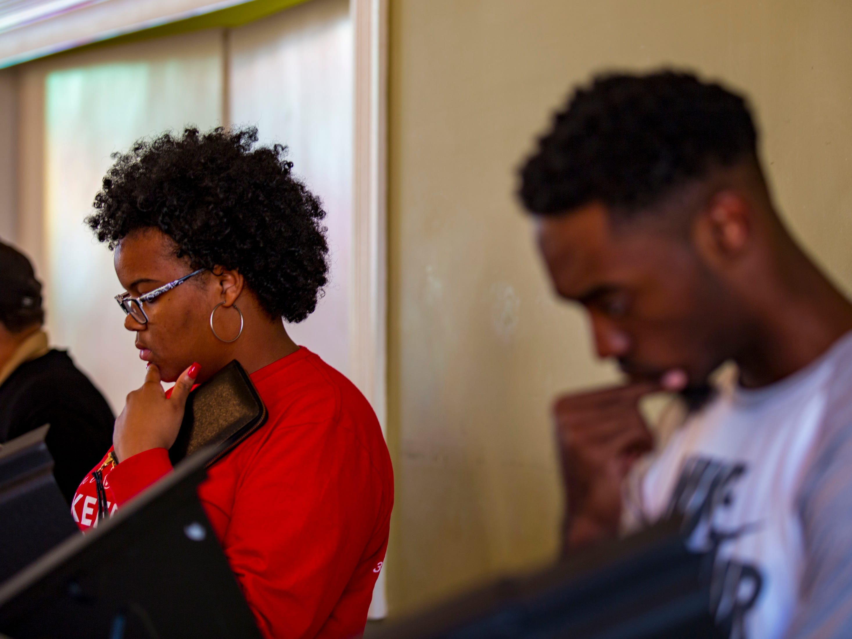 Desmond Parker, left, and Simeon Hall look over their ballots while voting at the Cathedral of Praise polling place in Nashville on Tuesday, Nov. 6, 2018.