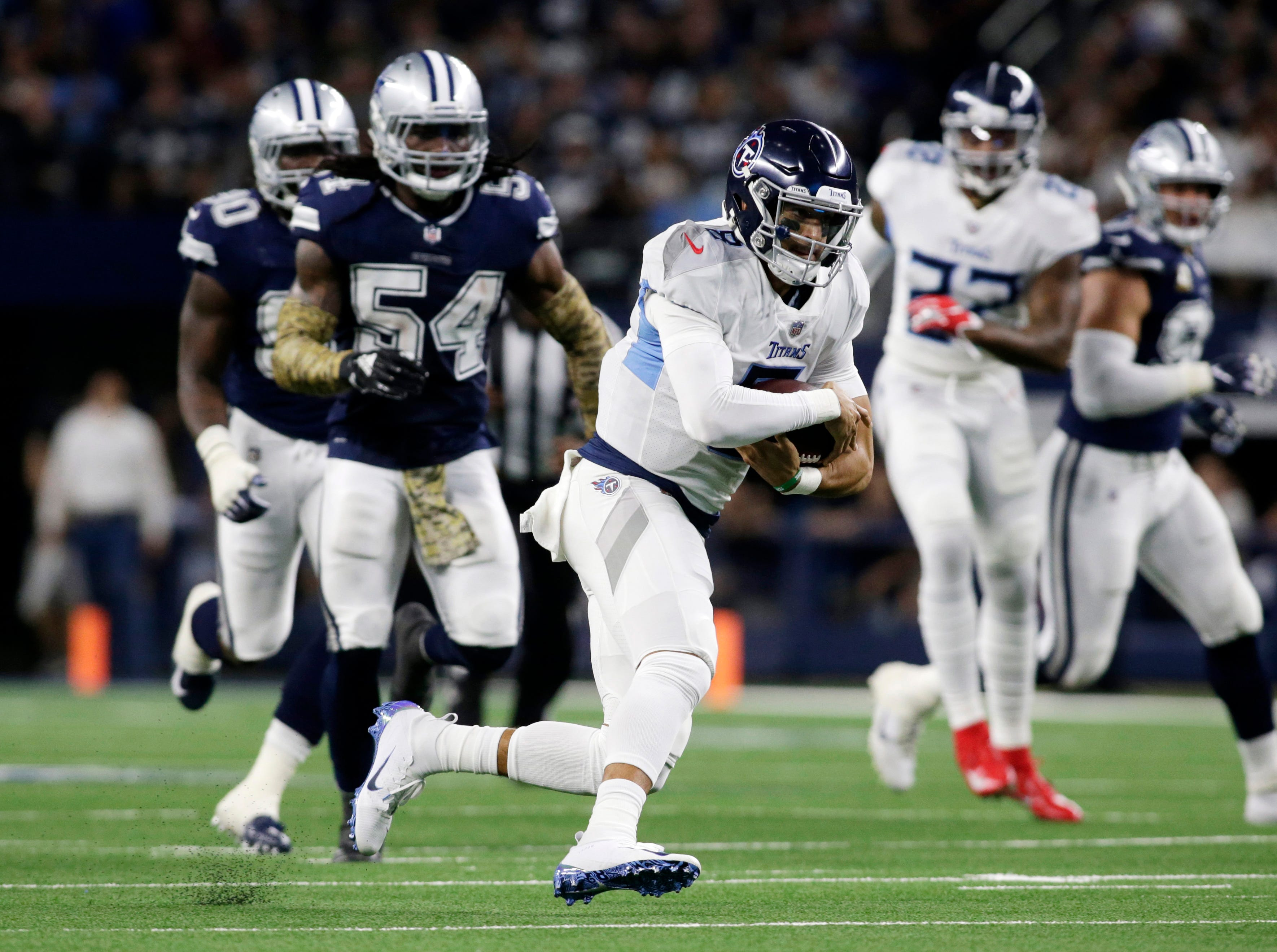 Nov 5, 2018; Arlington, TX, USA; Tennessee Titans quarterback Marcus Mariota (8) runs against the Dallas Cowboys in the second quarter at AT&T Stadium.