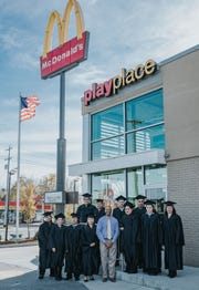English Under the Arches graduates and instructor Dan Conner celebrated their accomplishments at McDonald's in Gallatin.