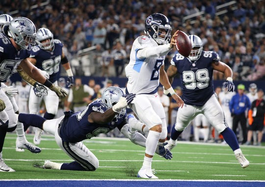 Nov 5, 2018; Arlington, TX, USA; Tennessee Titans quarterback Marcus Mariota (8) runs for a fourth quarter touchdown against Dallas Cowboys defensive end DeMarcus Lawrence (90) at AT&T Stadium.