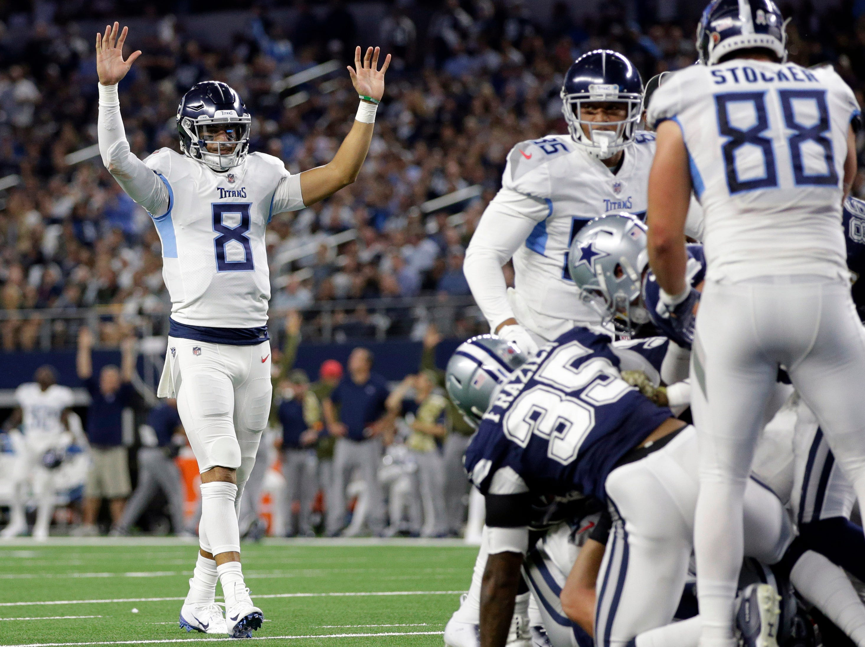 Nov 5, 2018; Arlington, TX, USA; Tennessee Titans quarterback Marcus Mariota (8) reacts to a touchdown in the second quarter against the Dallas Cowboys at AT&T Stadium.