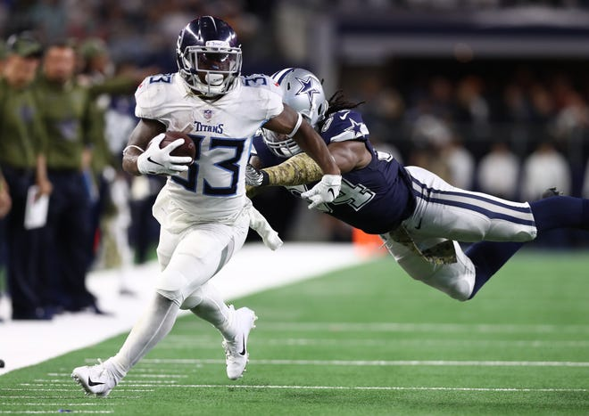 Cowboys linebacker Jaylon Smith tries to tackle Titans running back Dion Lewis (33) in the fourth quarter Monday.