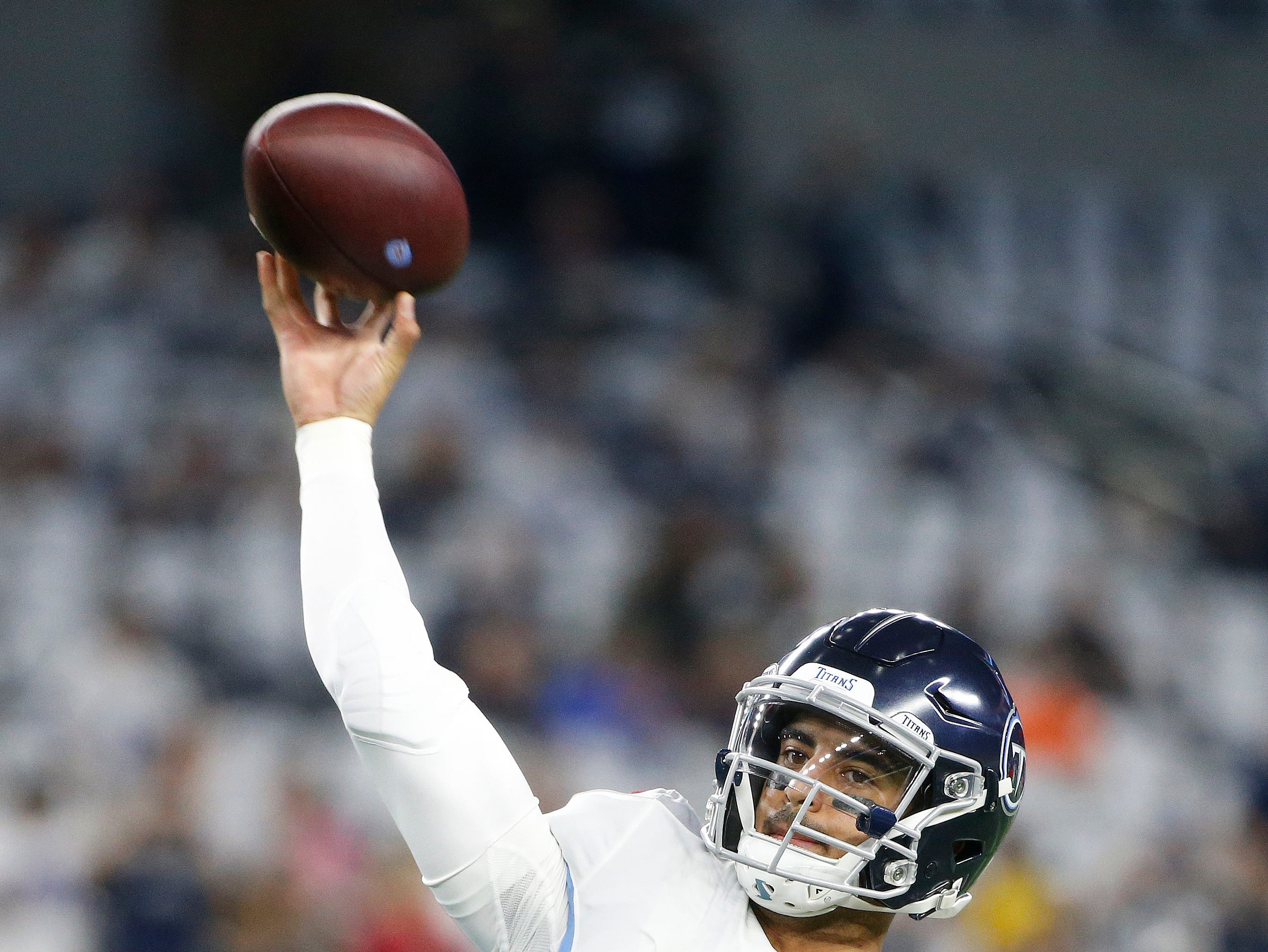 Tennessee Titans quarterback Marcus Mariota (8) warms up before the first half of an NFL football game between the Dallas Cowboys and the Tennessee Titans, Monday, Nov. 5, 2018, in Arlington, Texas.