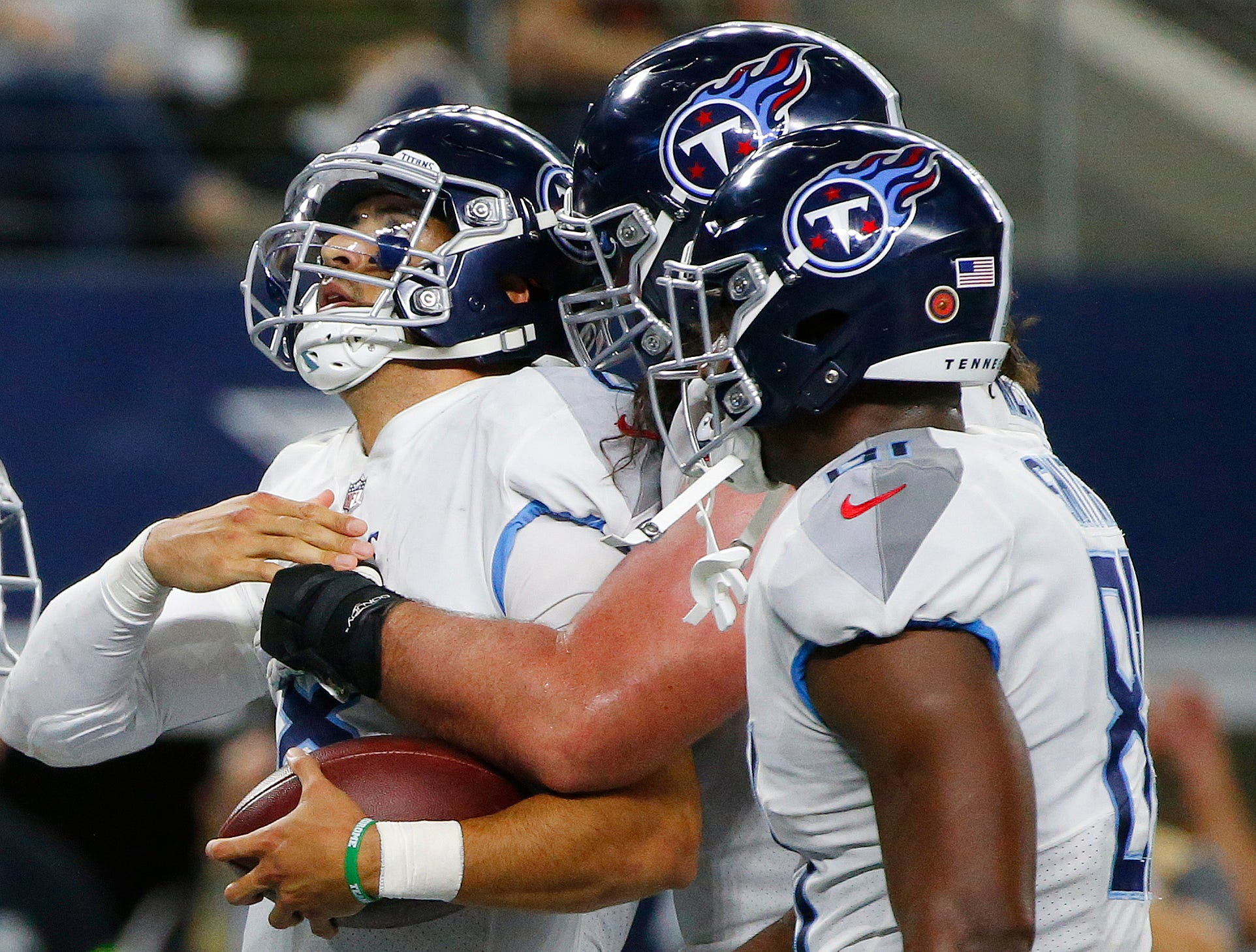 Tennessee Titans quarterback Marcus Mariota, left, celebrates his touchdown run with team mates during the second half of an NFL football game against the Dallas Cowboys, Monday, Nov. 5, 2018, in Arlington, Texas.