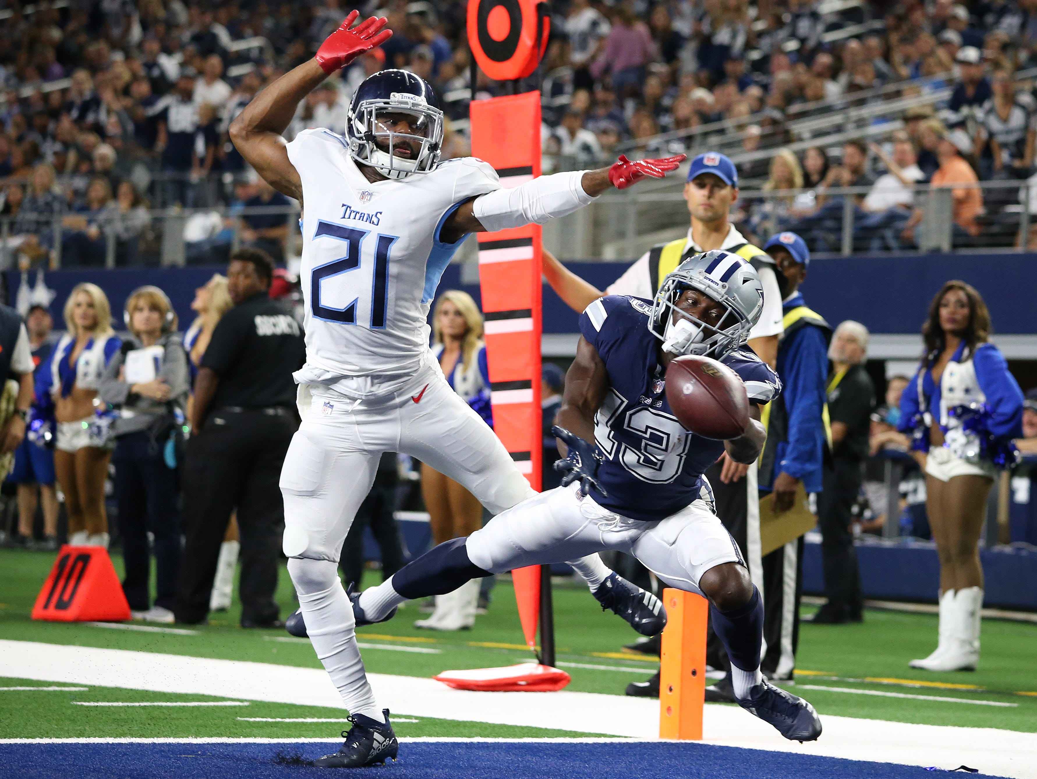Dallas Cowboys receiver Michael Gallup (13) can't make the reception against Tennessee Titans cornerback Malcolm Butler (21) in the fourth quarter at AT&T Stadium.