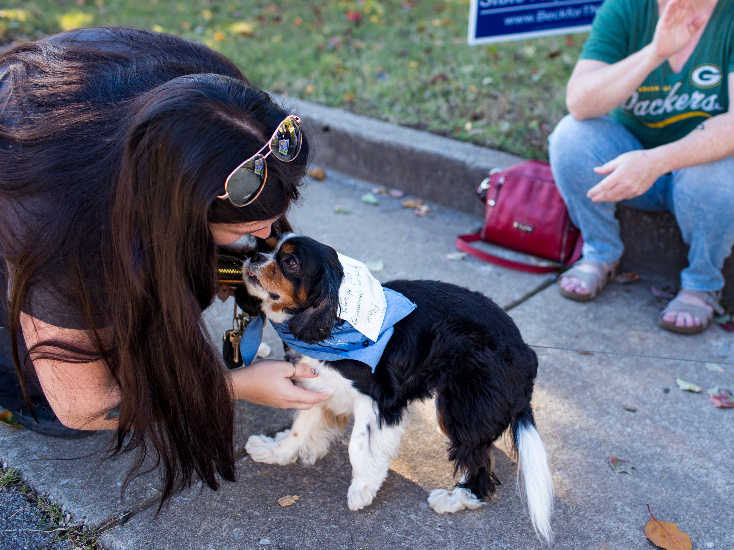 "Mandy Jones pets Simone Secours outside the Shelby Park Community Center polling place in Nashville on Tuesday, Nov. 6, 2018. According to her owner Molly Secours, Simone is a ""blue dog Democrat."""