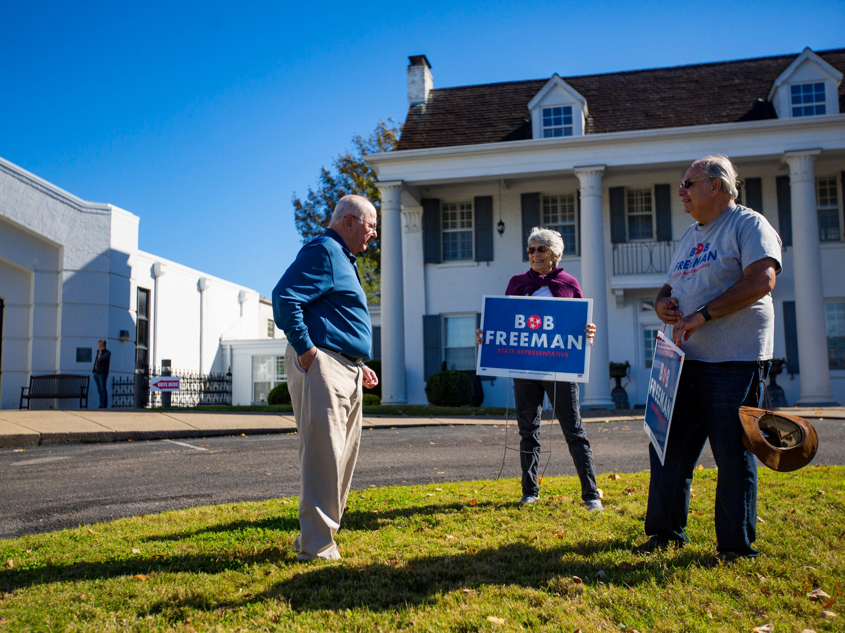Stewart Kresge speaks with Pat McDonald and Roger Schecter, who hold Bob Freeman campaign signs, outside of the Hillsboro Presbyterian Church polling place in Nashville on Tuesday, Nov. 6, 2018.