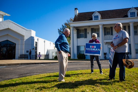 Pat McDonald and Roger Schecter Bob Freeman campaign signs while speaking to Stewart Kresge outside of the Hillsboro Presbyterian Church polling place on Nov. 6. Freeman defeated Republican Brent Moody in the House District 56 race.