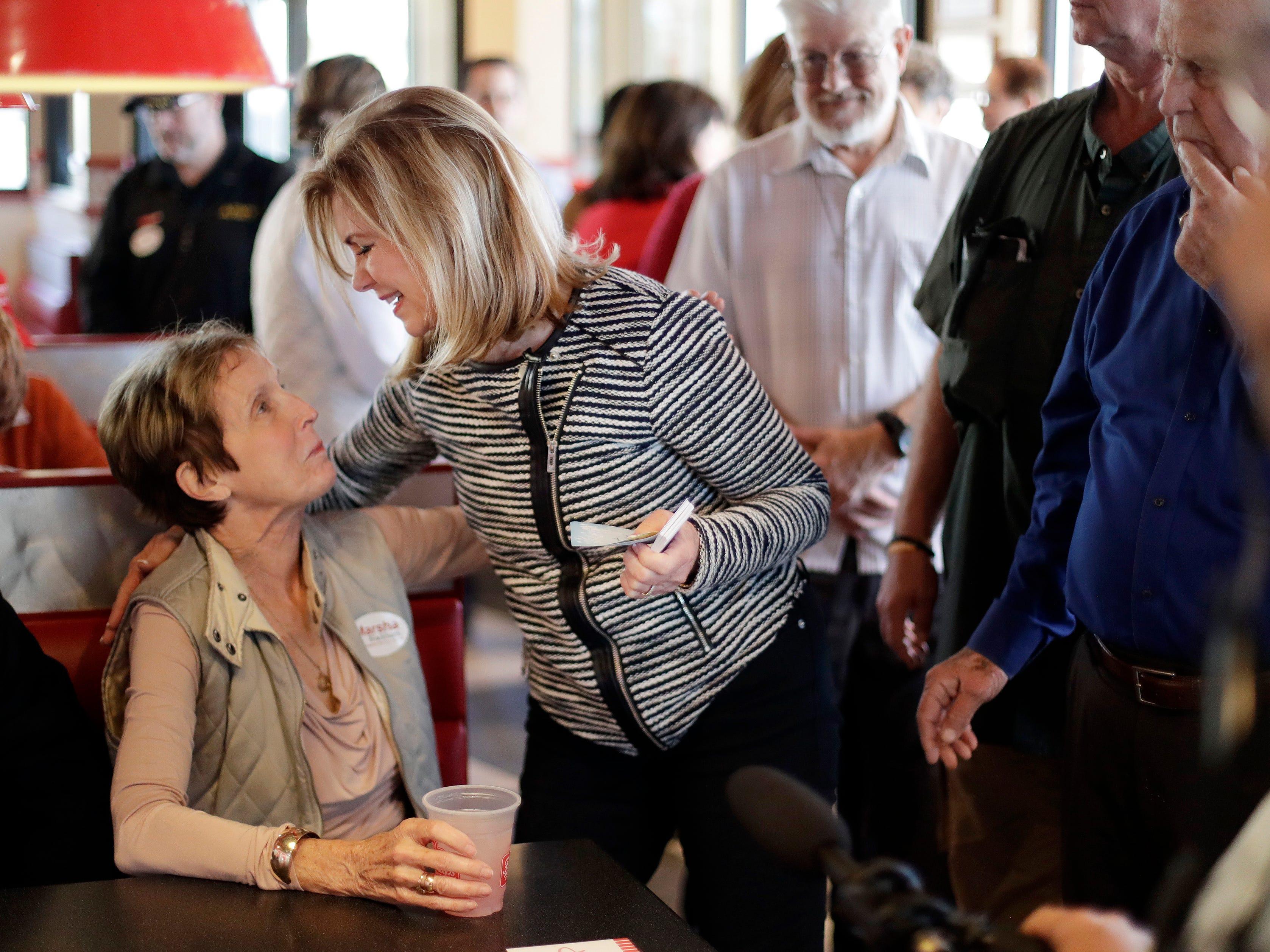 Rep. Marsha Blackburn, R-Tenn., center, campaigns at Freddy's Frozen Custard & Steakburgers, Tuesday, Nov. 6, 2018, in Clarksville, Tenn. Blackburn is running against former Gov. Phil Bredesen for the U.S. Senate.