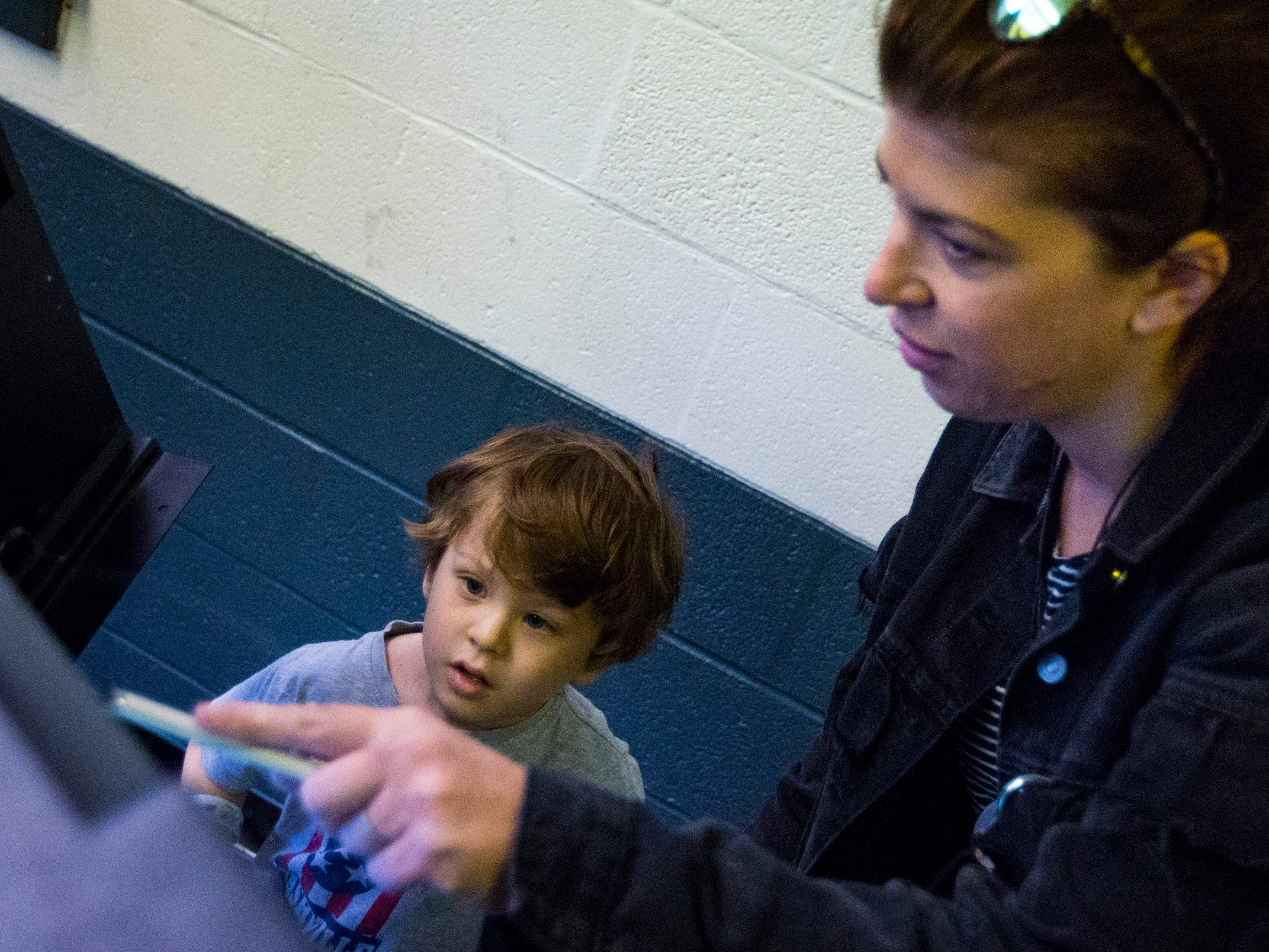 Stone Scheideman, 5, helps his mom, Marissa Moss vote at the Shelby Park Community Center in Nashville on Tuesday, Nov. 6, 2018.