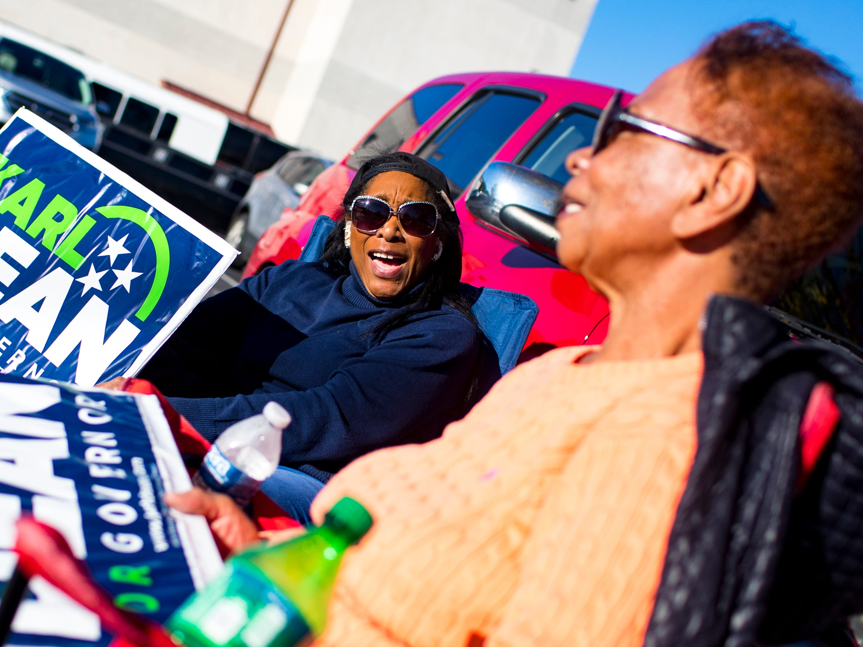 Dr. LaVern Hill, center, and Laura Flowers joke around while campaigning for Karl Dean at the Cathedral of Praise polling place in Nashville on Tuesday, Nov. 6, 2018.