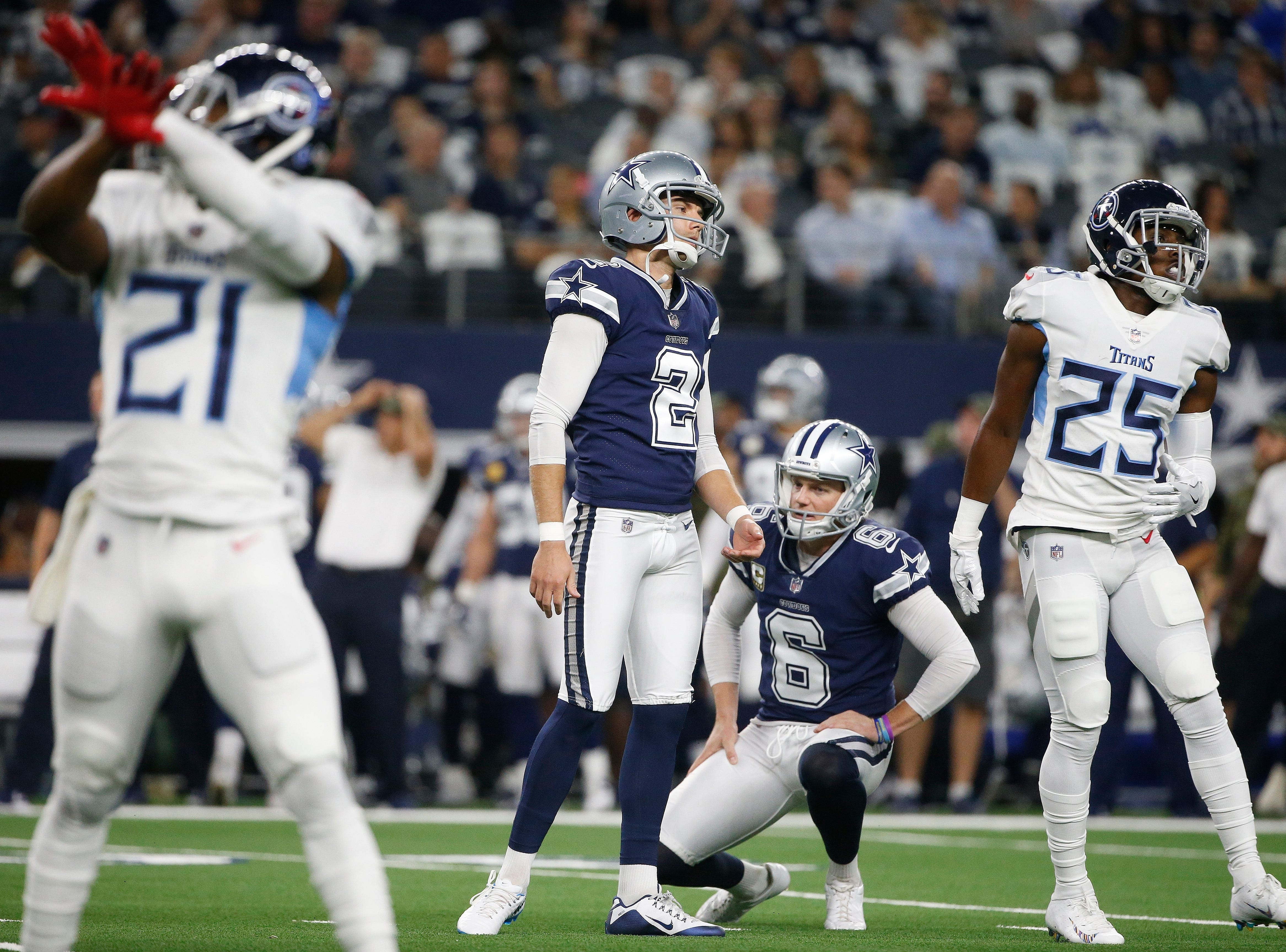 Dallas Cowboys kicker Brett Maher (2) attempts a field goal and reacts after missing the shot against the Tennessee Titans during the first half of an NFL football game, Monday, Nov. 5, 2018, in Arlington, Texas.