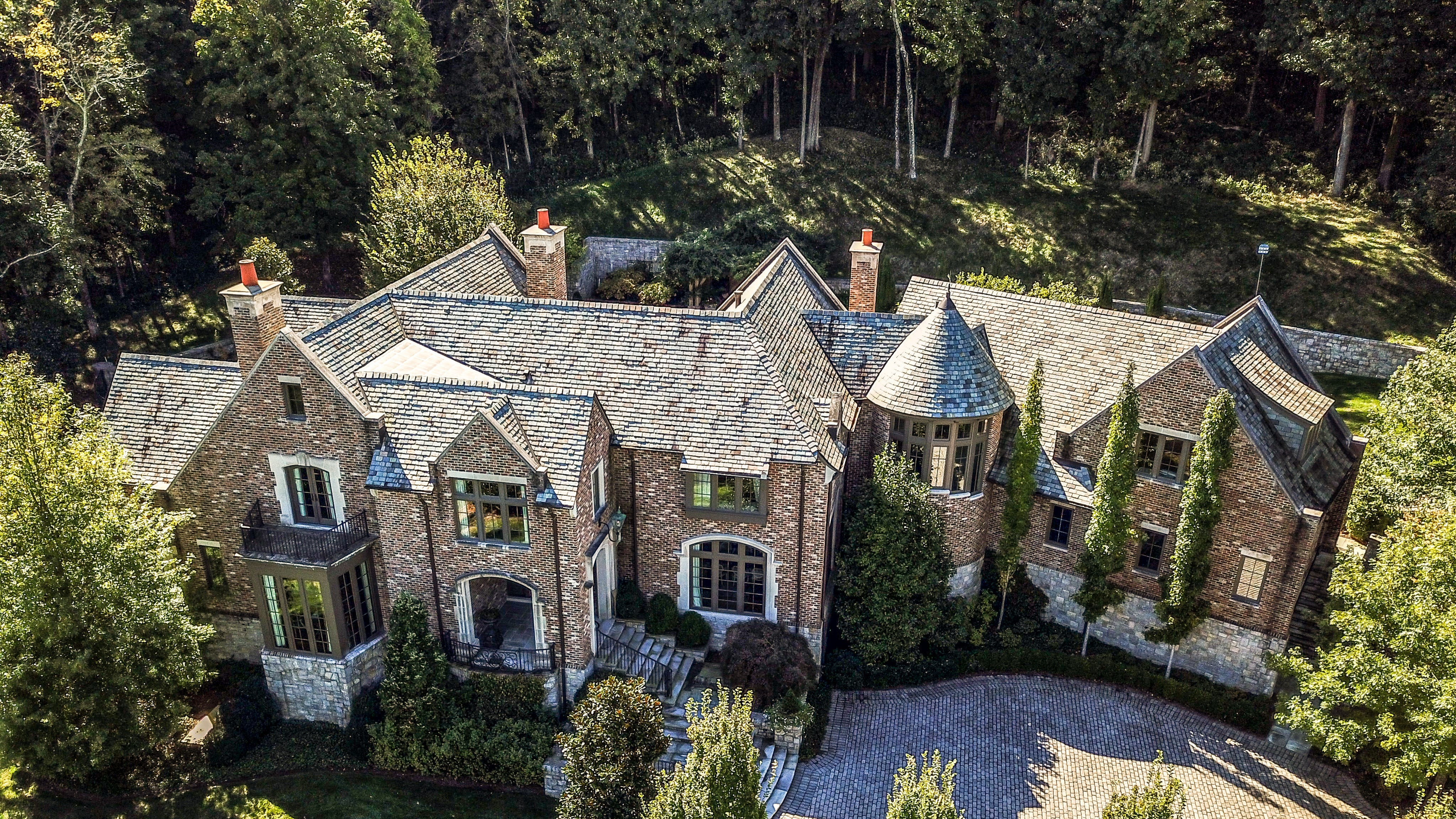 The 5-acre property at 919 Overton Lea Road backs up to Radnor Lake State Park.