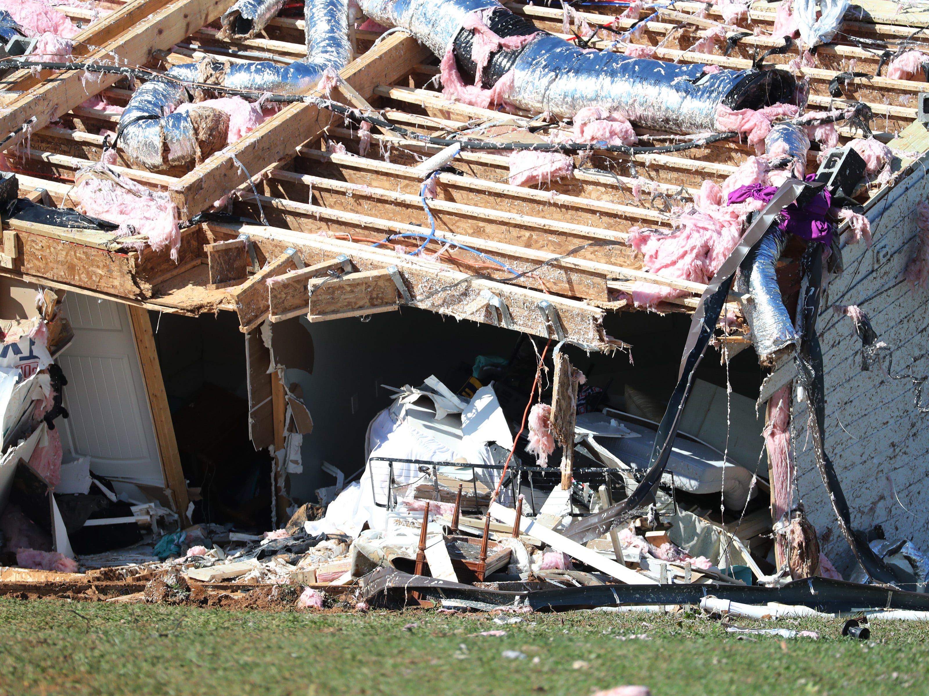 A home rests on its side after a possible tornado blew the family's house off its foundation on Midland Road  Tuesday, Nov. 6, 2018, in Christiana, Tenn.