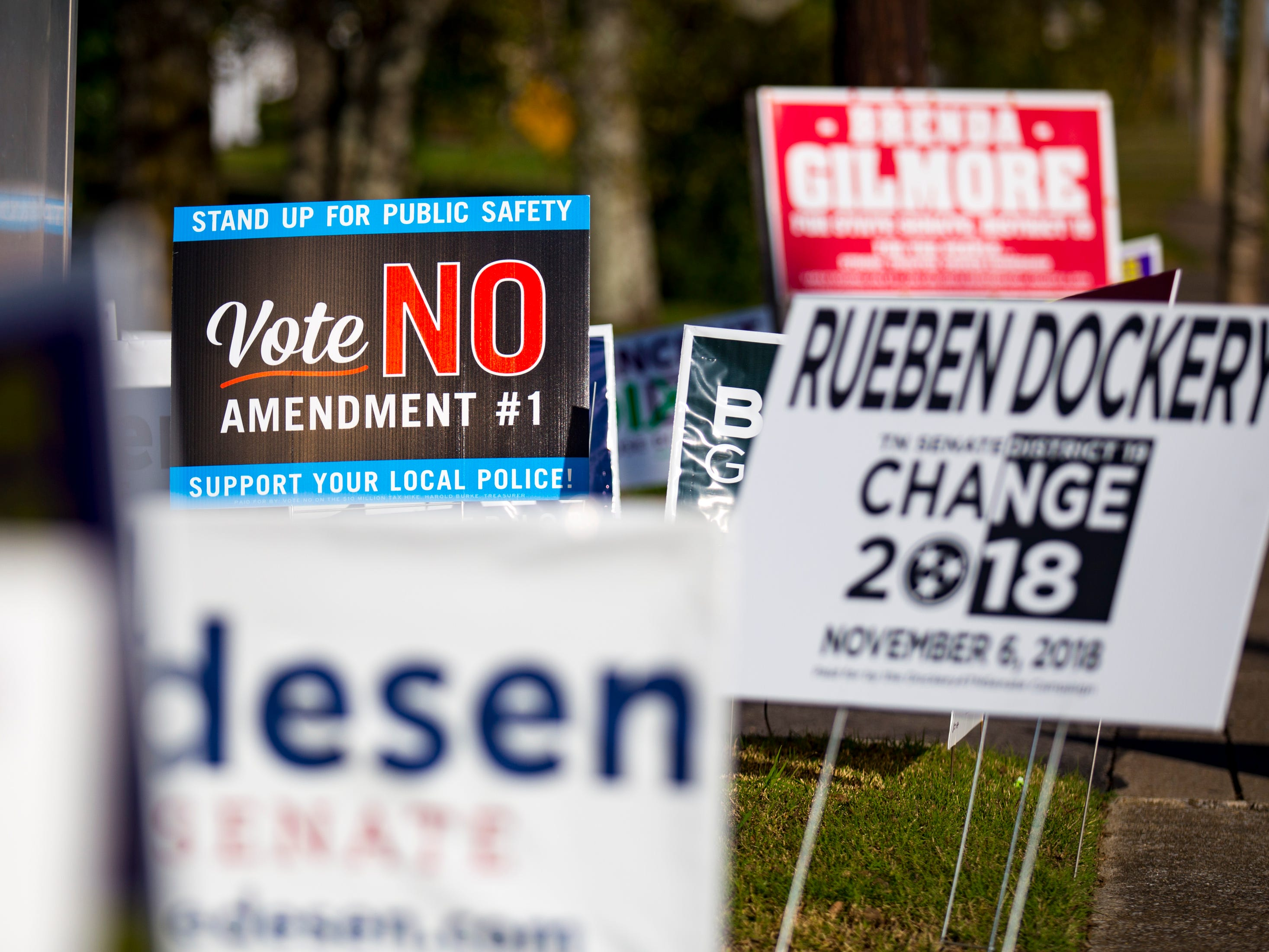 Campaign signs line the entrance to the parking lot at the Cathedral of Praise polling place in Nashville on Tuesday, Nov. 6, 2018.
