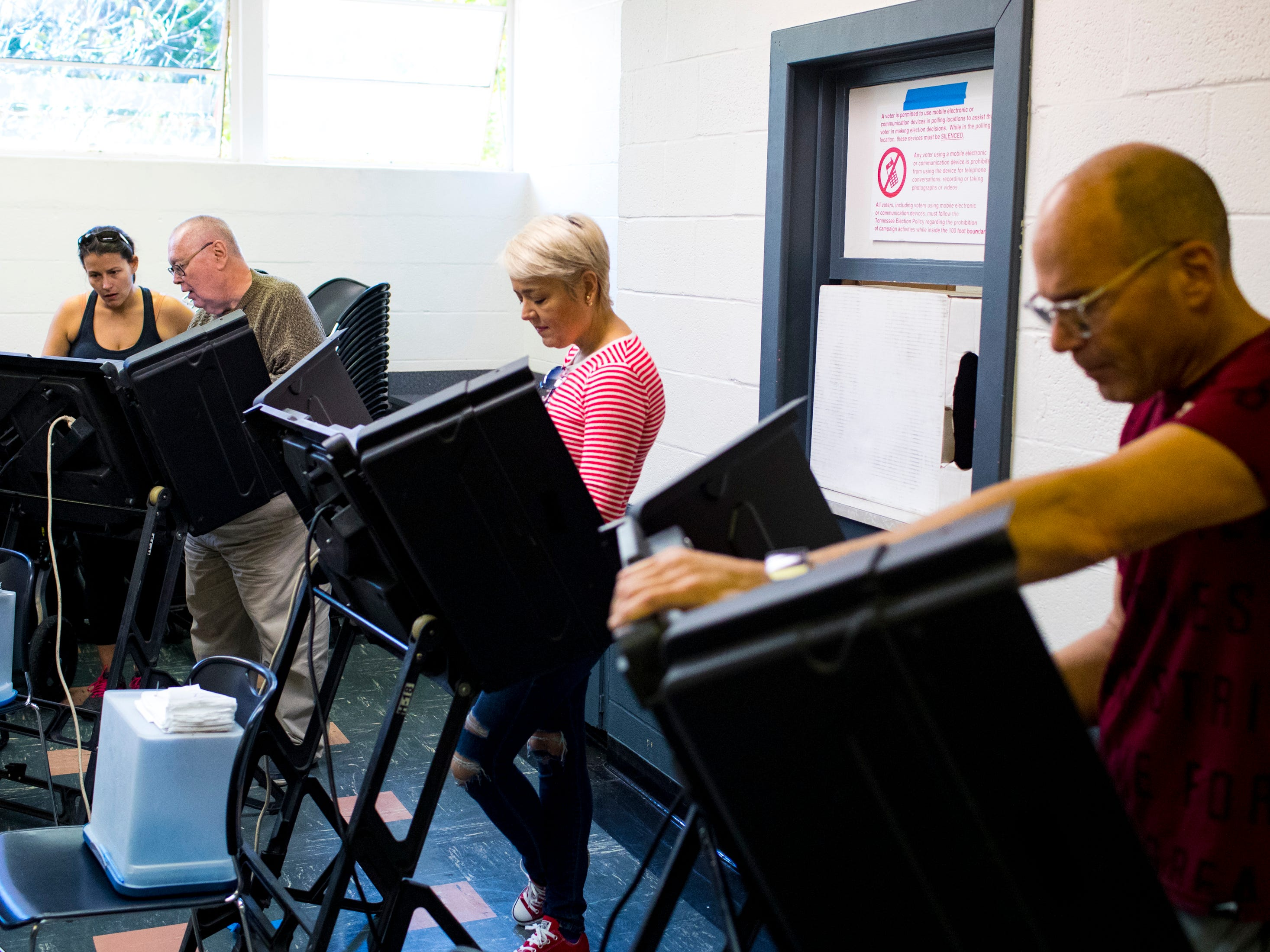 People vote at the Shelby Park Community Center polling place in Nashville on Tuesday, Nov. 6, 2018.