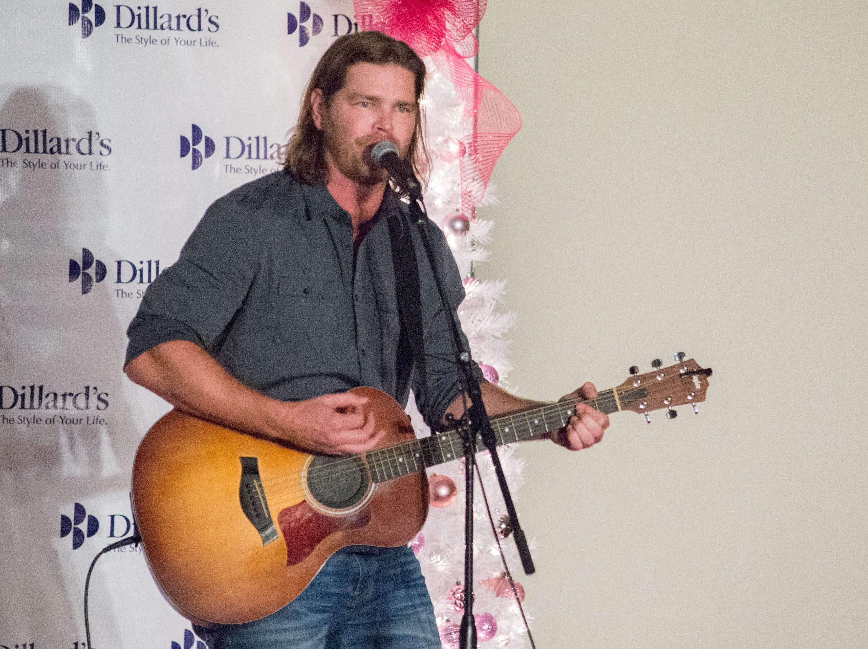 Travis Rice performs during the Garlands & Glitter Fashion Show by Dillard's presented by Hendersonville HolidayFest at Bluegrass Yacht and Country Club in Hendersonville on Saturday, Nov. 3. The event was to benefit the YMCA After Breast Cancer Program.