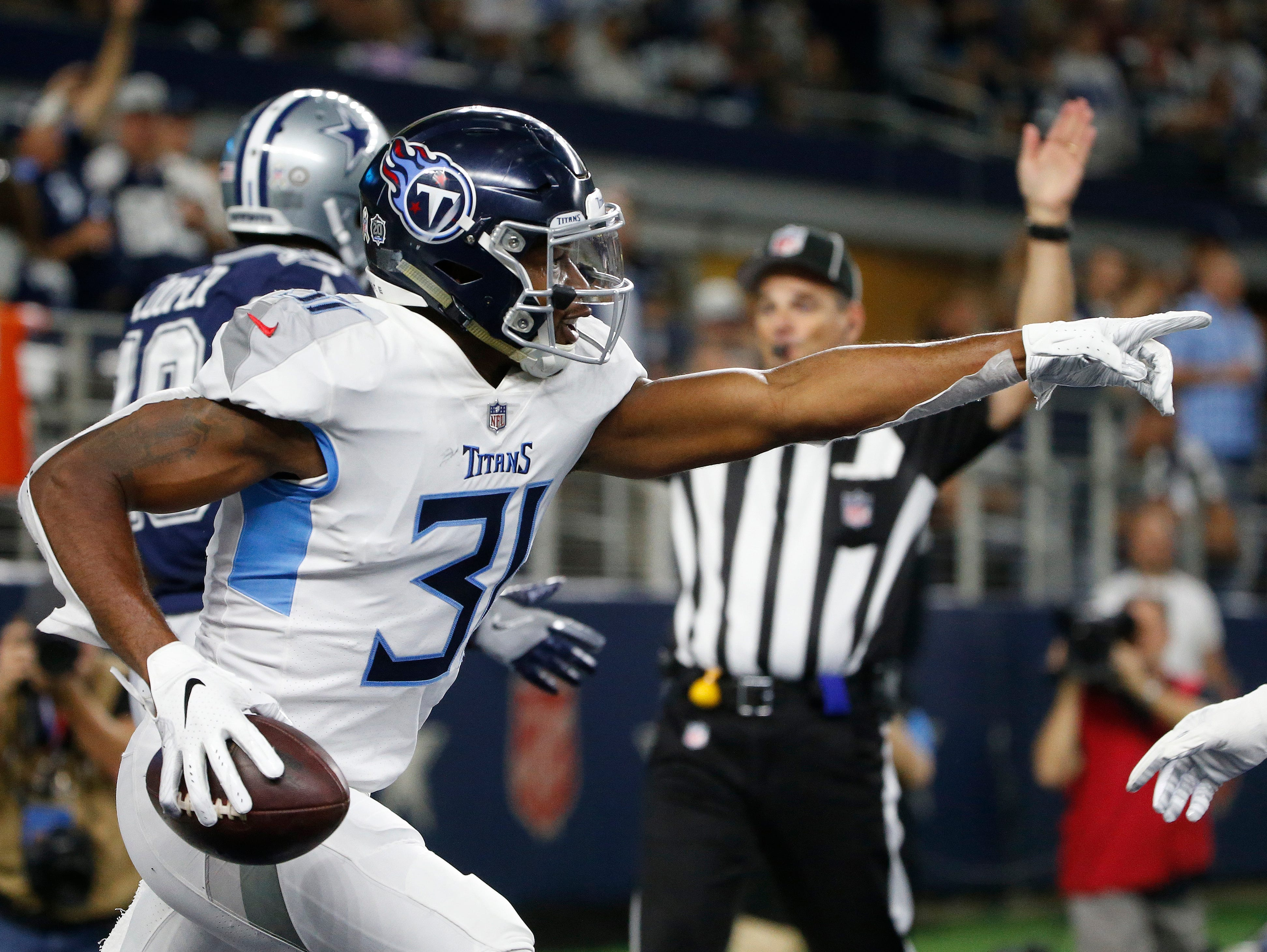 Titans safety Kevin Byard (31) celebrates his interception against the Dallas Cowboys the first half of an NFL football game, Monday, Nov. 5, 2018, in Arlington, Texas.