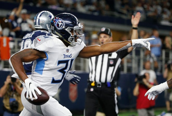 Titans safety Kevin Byard (31) celebrates his interception against the Cowboys on Monday night.