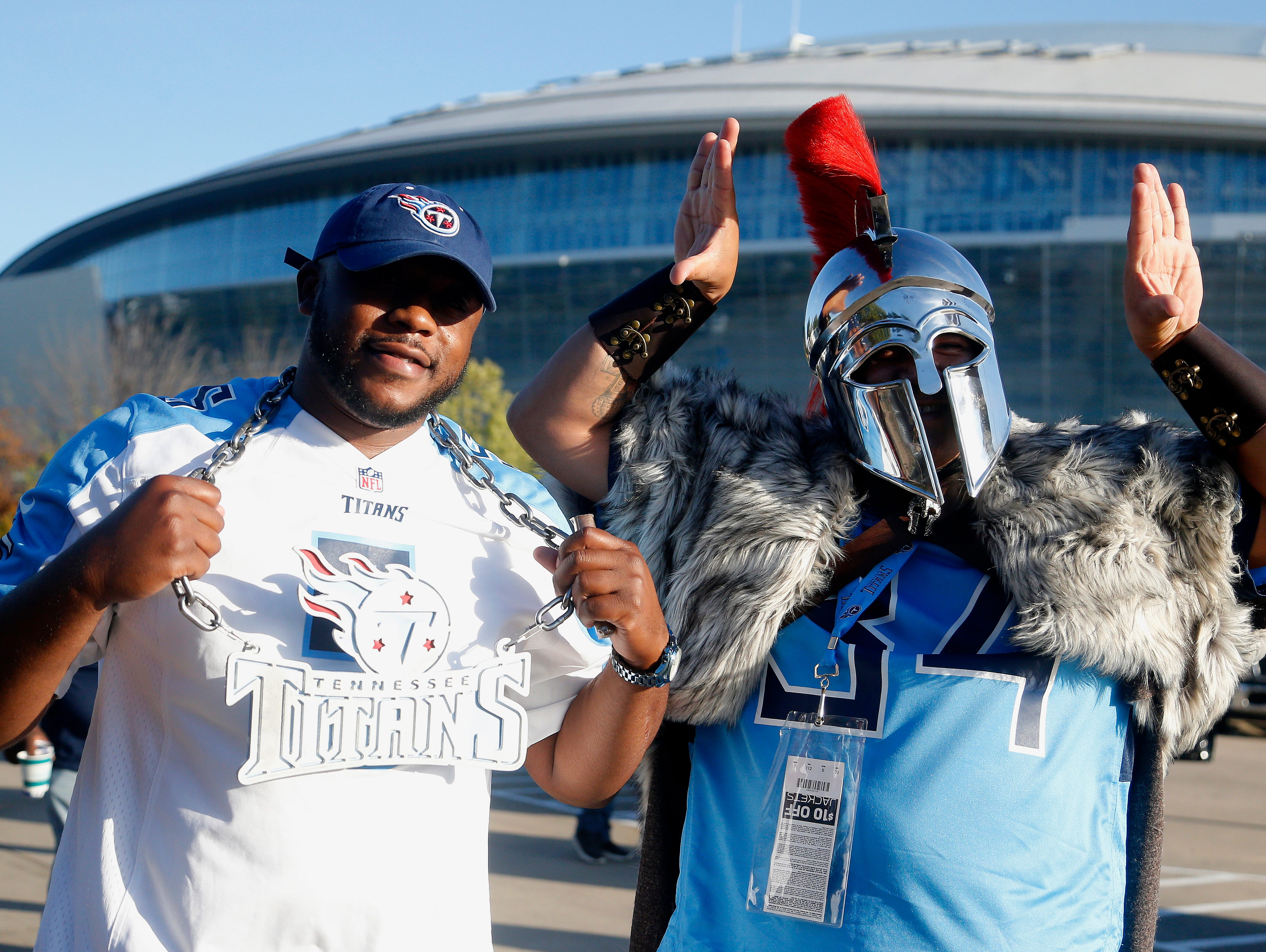Tennessee Titans fans walk into the stadium before the first half of an NFL football game between the Dallas Cowboys and the Tennessee Titans, Monday, Nov. 5, 2018, in Arlington, Texas.