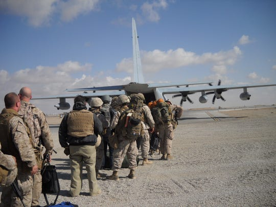 Aaron Dorn and his platoon load onto a military aircraft that took them to Afghanistan in January 2011.