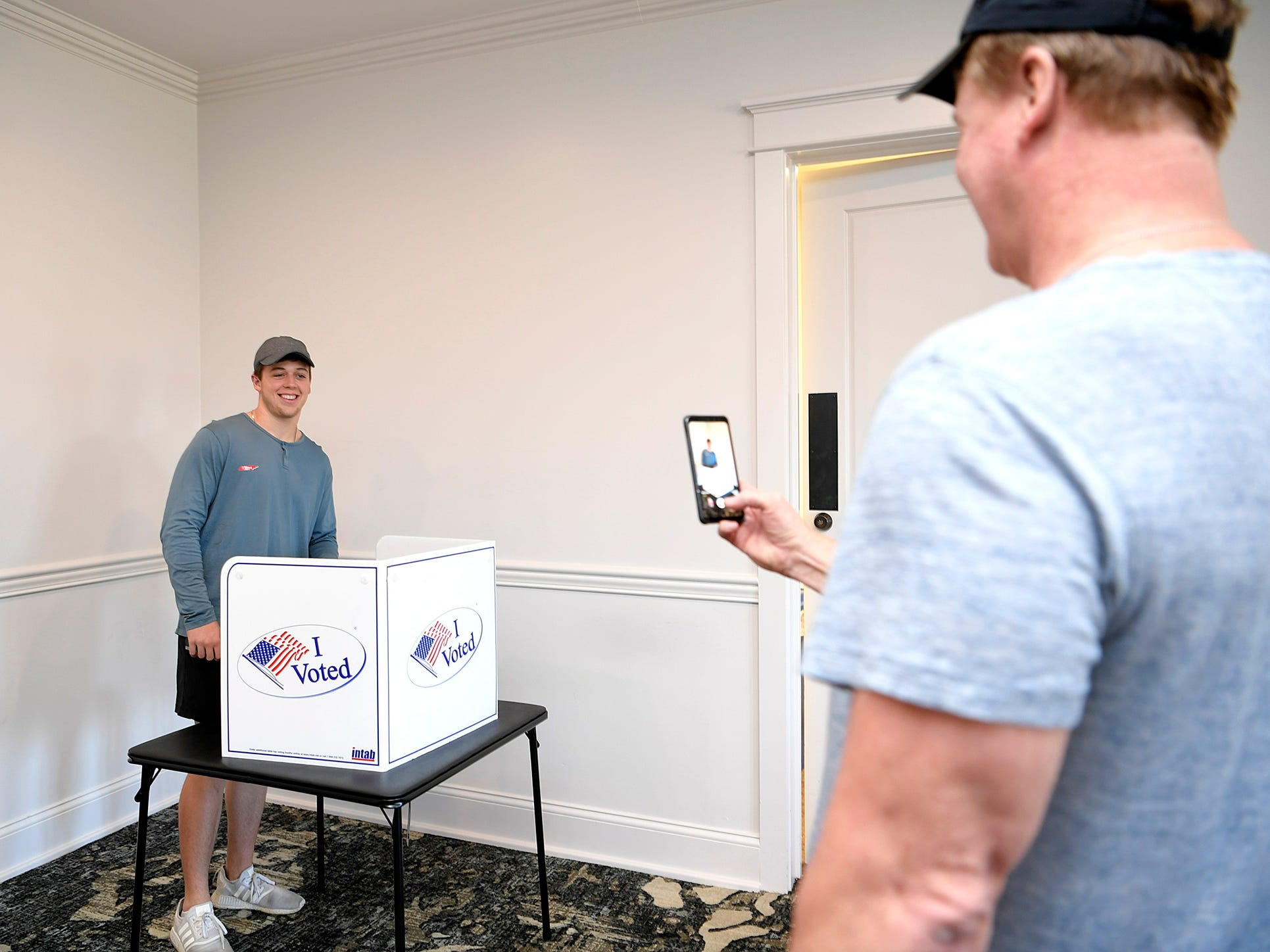 Bill Huff of Franklin celebrates his son, Brandon Huff,19, voting for the first time with a photo at the Westhaven Clubhouse polling location in Franklin, Tenn. on Tuesday, Nov. 6, 2018.
